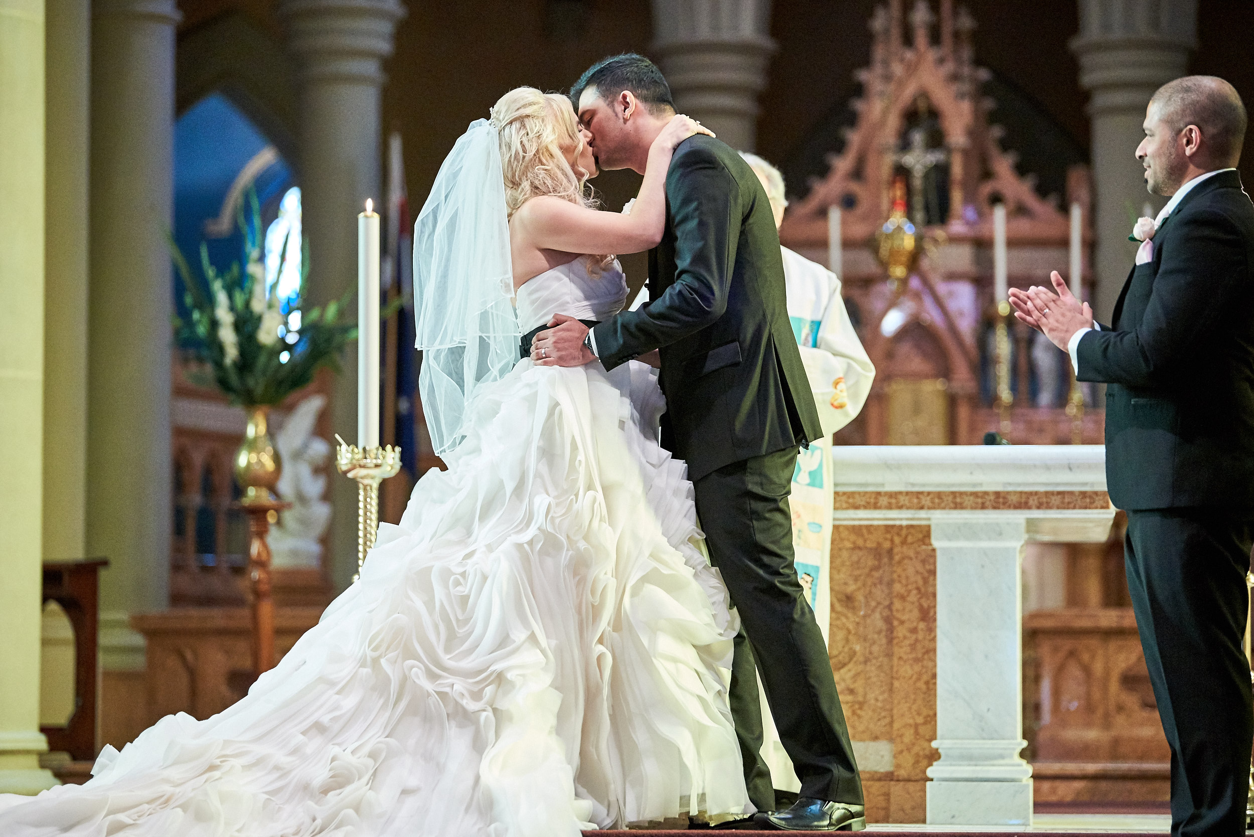 Bride and groom kissing at St Mary of the Angels Basilica in Geelong