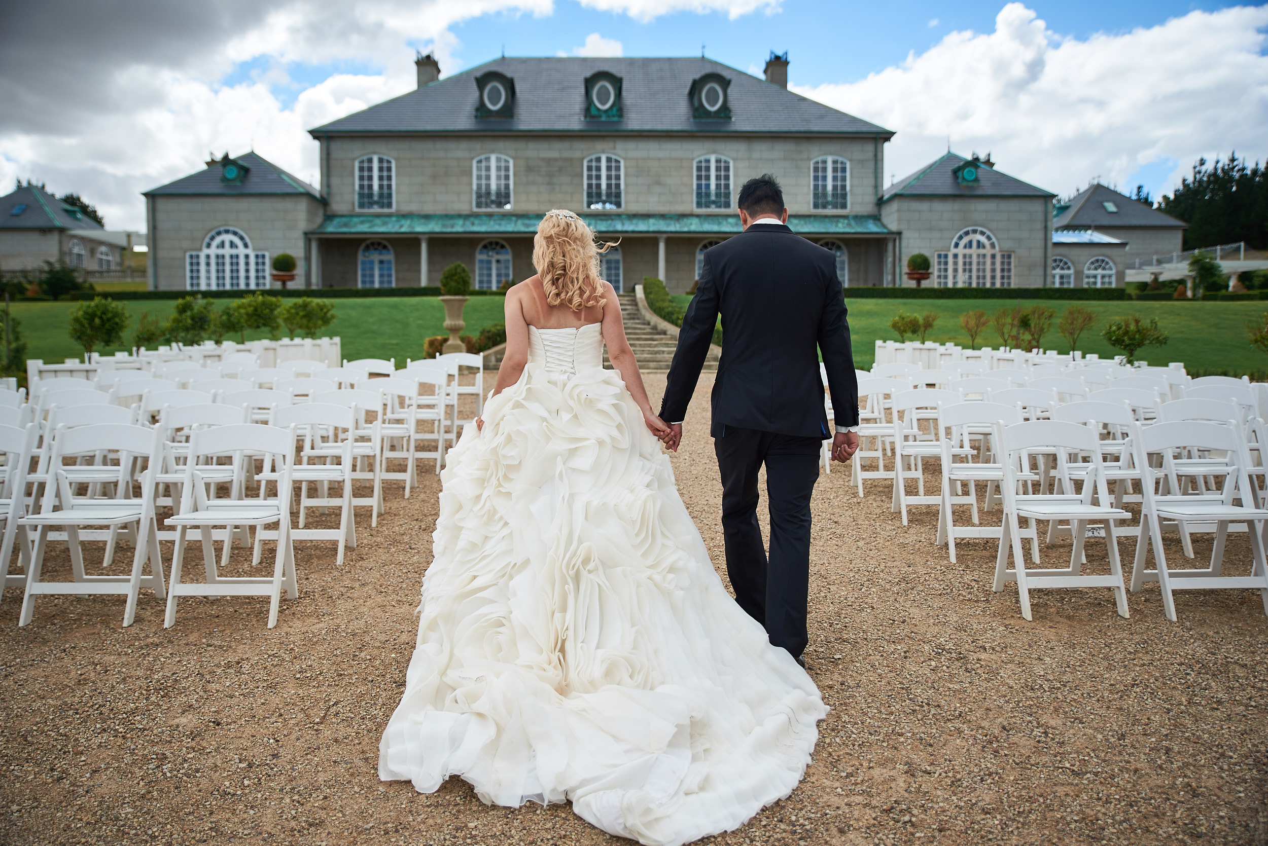 Bride and groom holding hands and walking at Campbell Point House