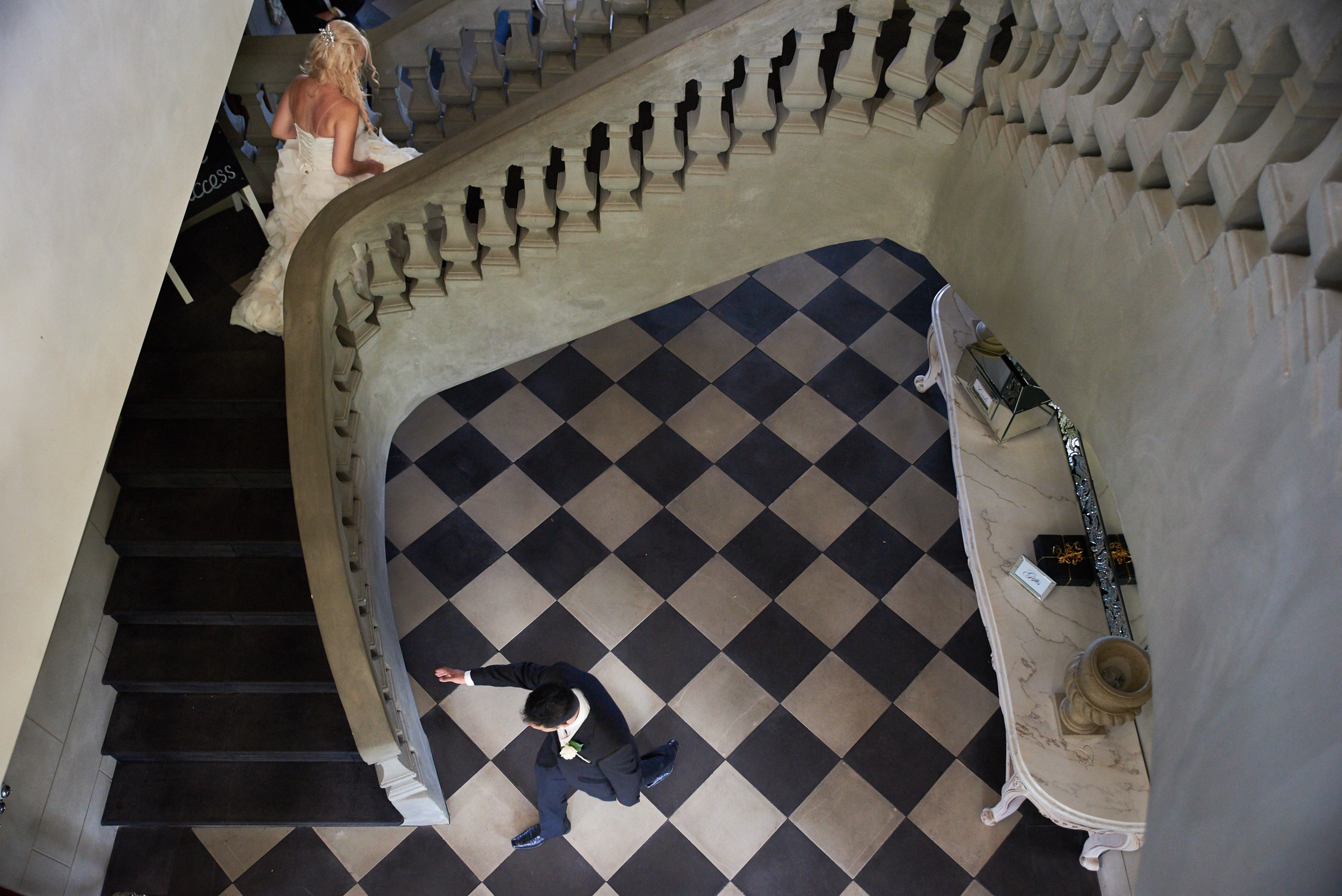 Bride and groom walking up staircase at Campbell Point House