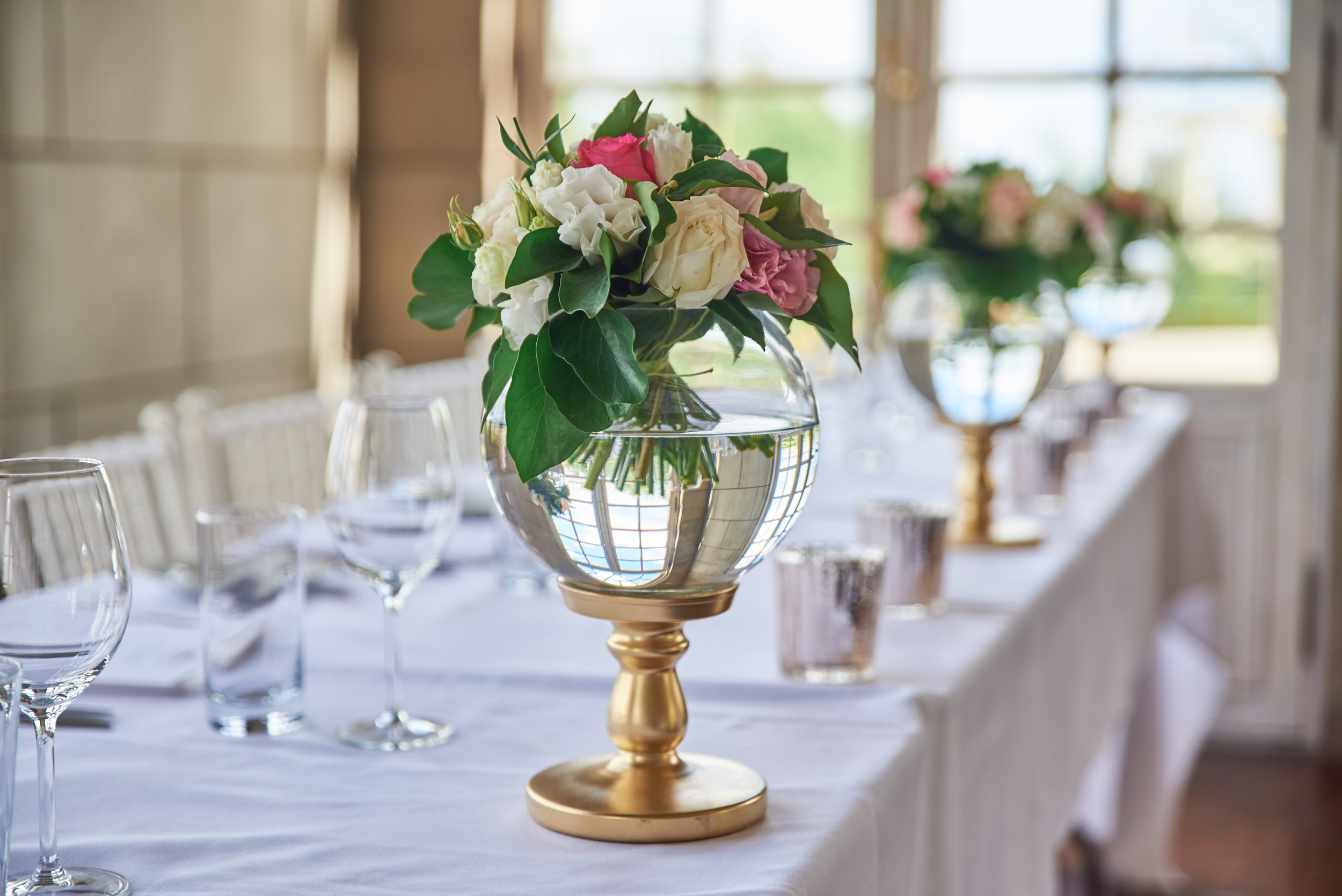 Table decorations at Campbell Point House wedding reception