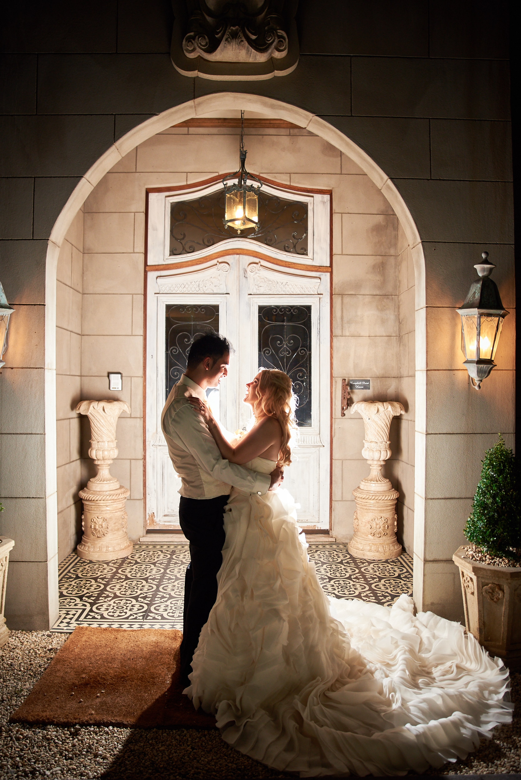 Bride and groom portrait in doorway at Campbell Point House
