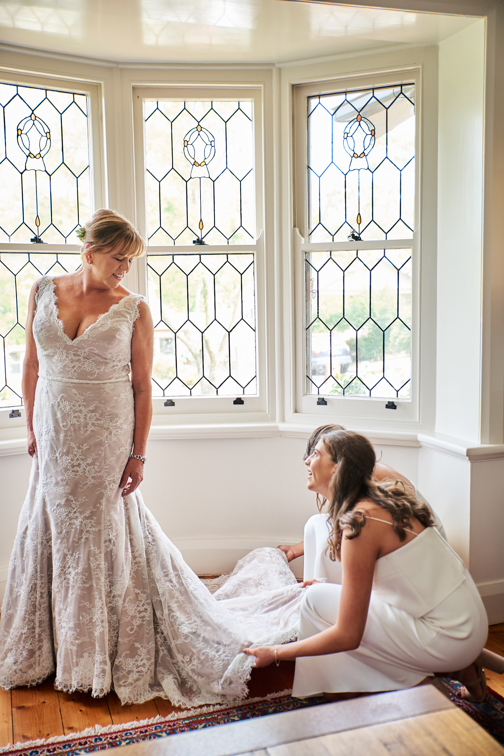 Bride and bridesmaids adjusting dress non-hipster wedding.jpg