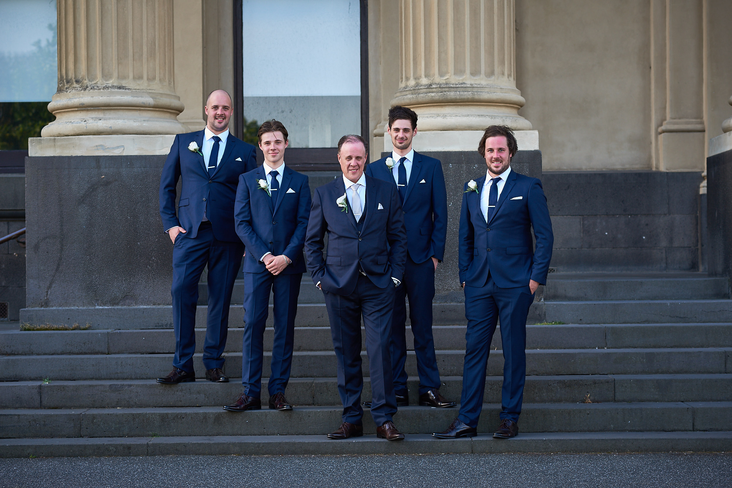 Groom with groomsmen on steps at Port Melbourne Town Hall non-hipster wedding.jpg