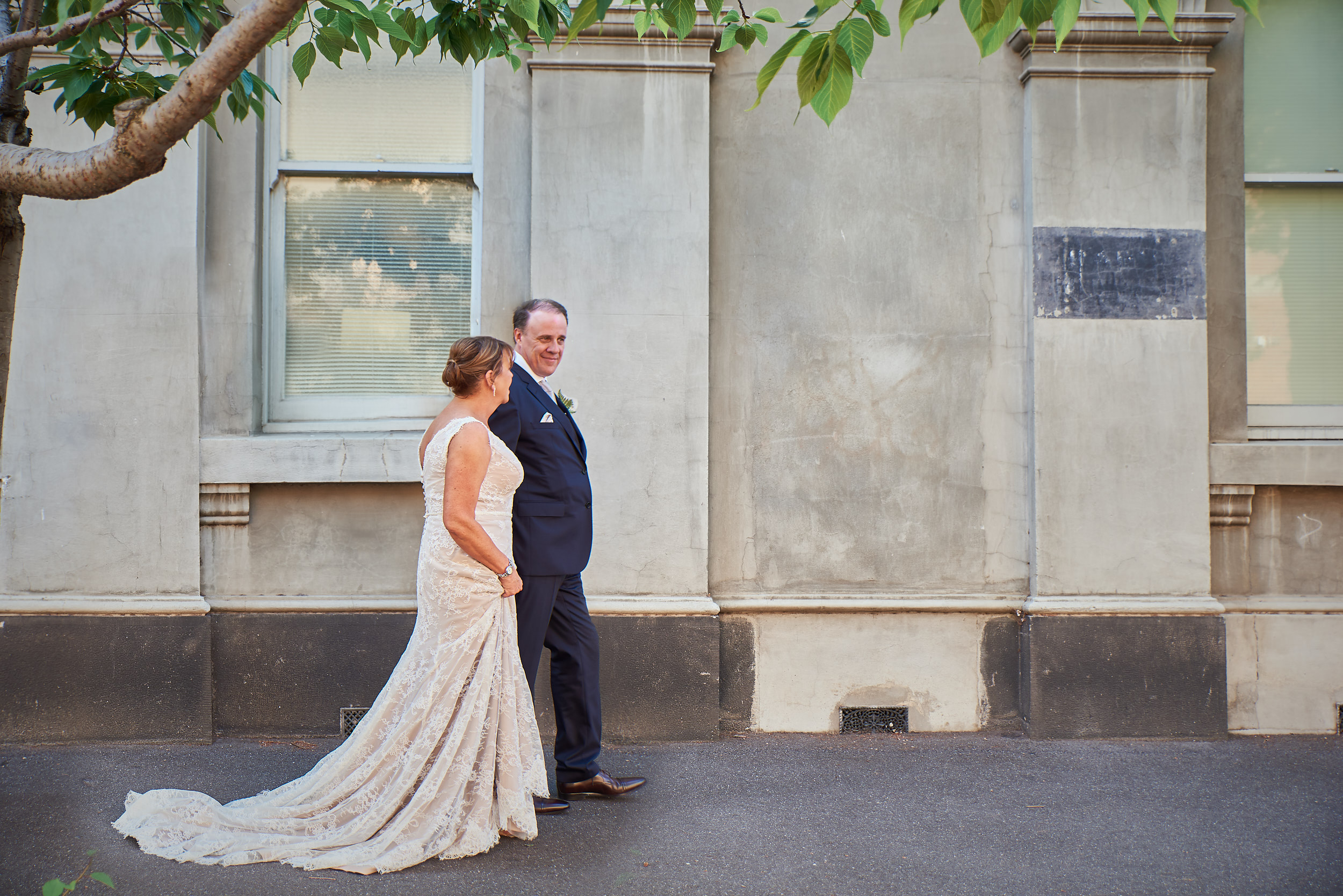 Bride and groom walking portrait non-hipster wedding.jpg