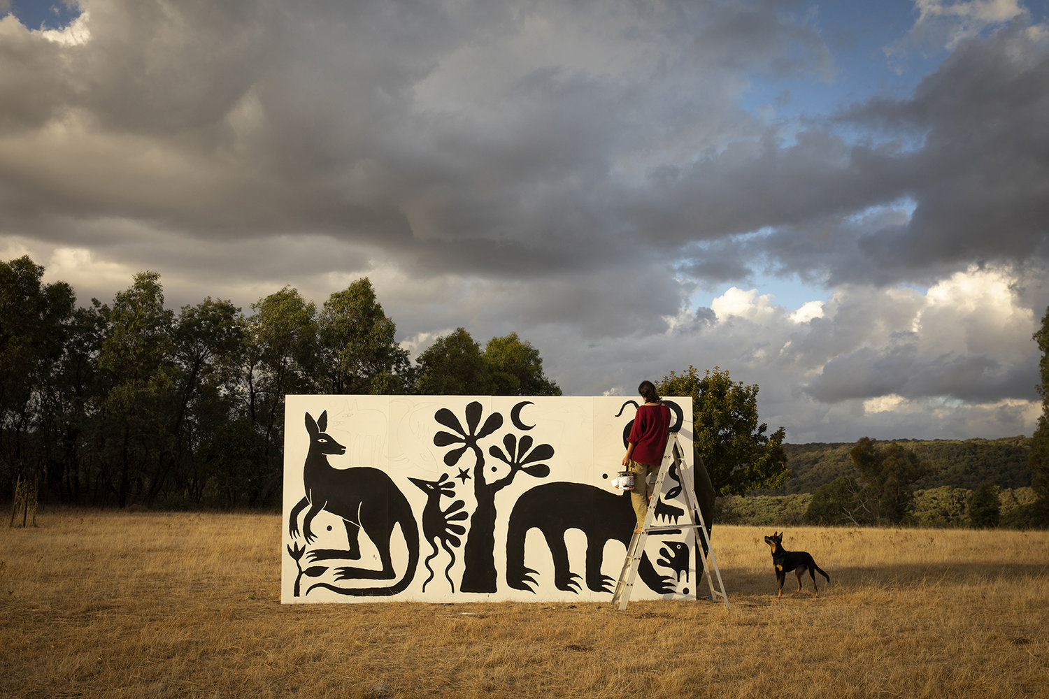 Leunig at work on one of her murals. Click to see more.