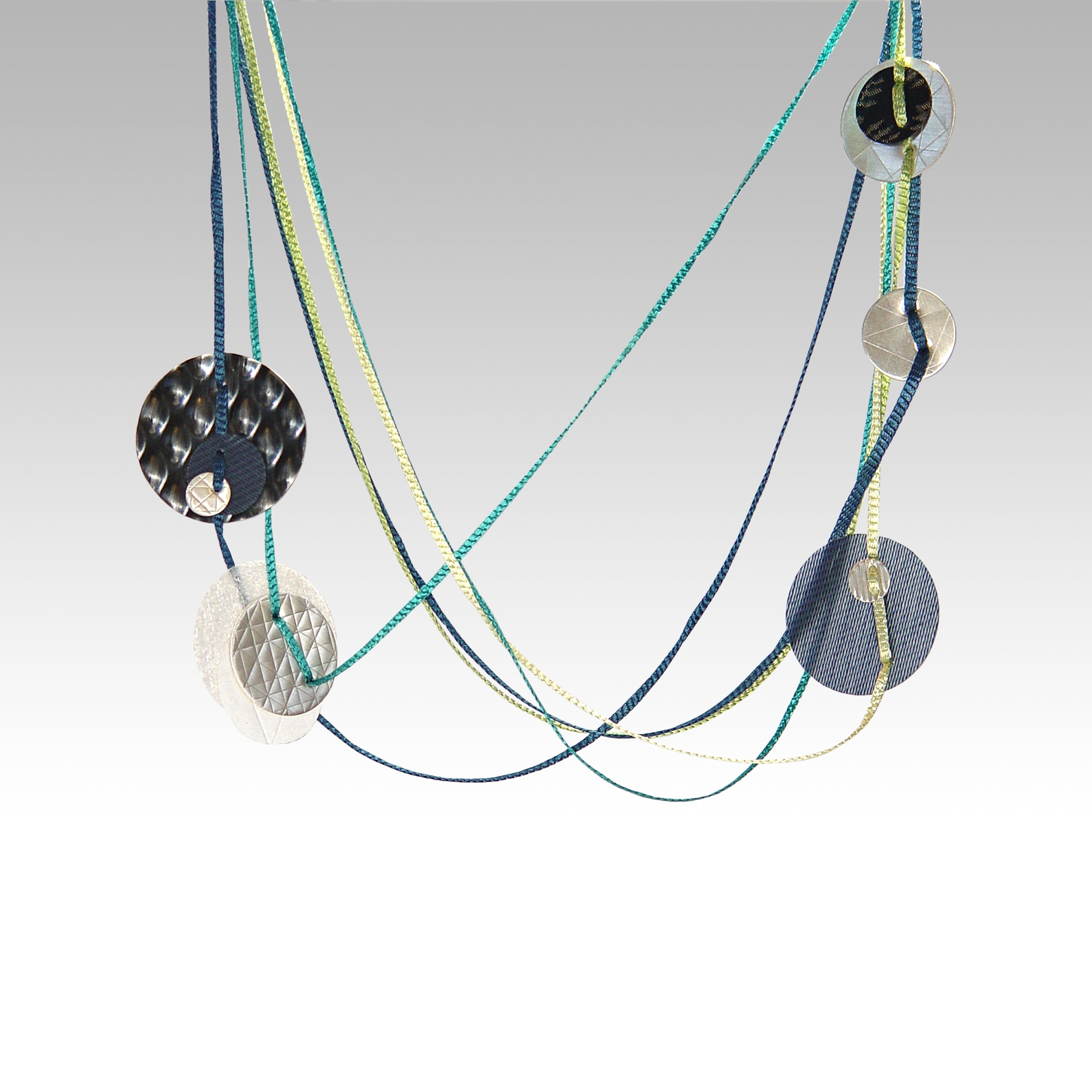 Jazz necklace with metallic and textural discs