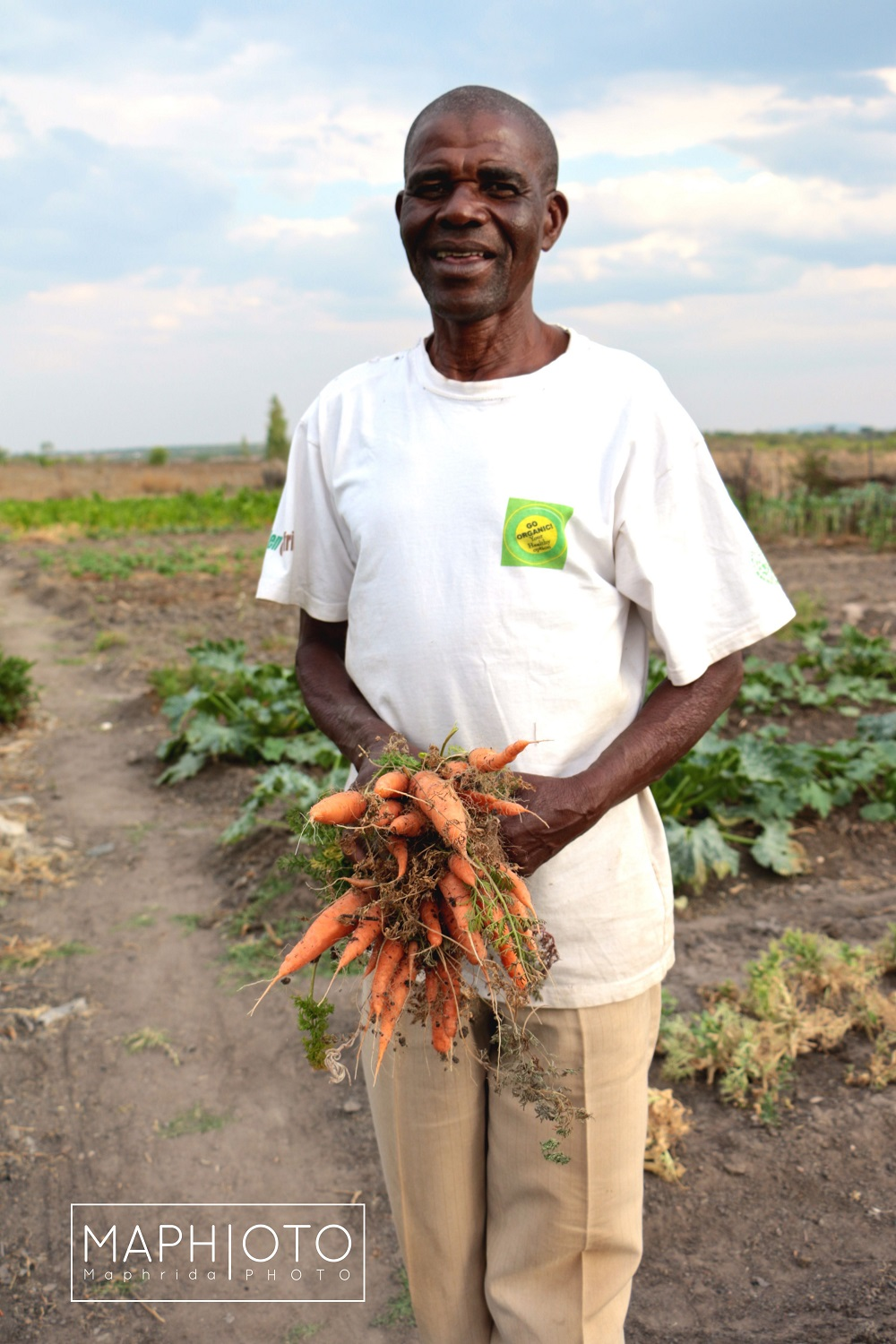 """Normal   0       21       false   false   false     DE-CH   X-NONE   X-NONE                                                                          Organic farmer from Wedza District with his organic carrots. Photo: Maphrida Forichi                                                                                                                                                                                                                                                                                              /* Style Definitions */  table.MsoNormalTable {mso-style-name:""""Table Normal""""; mso-tstyle-rowband-size:0; mso-tstyle-colband-size:0; mso-style-noshow:yes; mso-style-priority:99; mso-style-parent:""""""""; mso-padding-alt:0cm 5.4pt 0cm 5.4pt; mso-para-margin:0cm; mso-para-margin-bottom:.0001pt; mso-pagination:none; font-size:11.0pt; font-family:""""Calibri"""",""""sans-serif""""; mso-ascii-font-family:Calibri; mso-ascii-theme-font:minor-latin; mso-hansi-font-family:Calibri; mso-hansi-theme-font:minor-latin; mso-ansi-language:EN-US; mso-fareast-language:EN-US;}"""