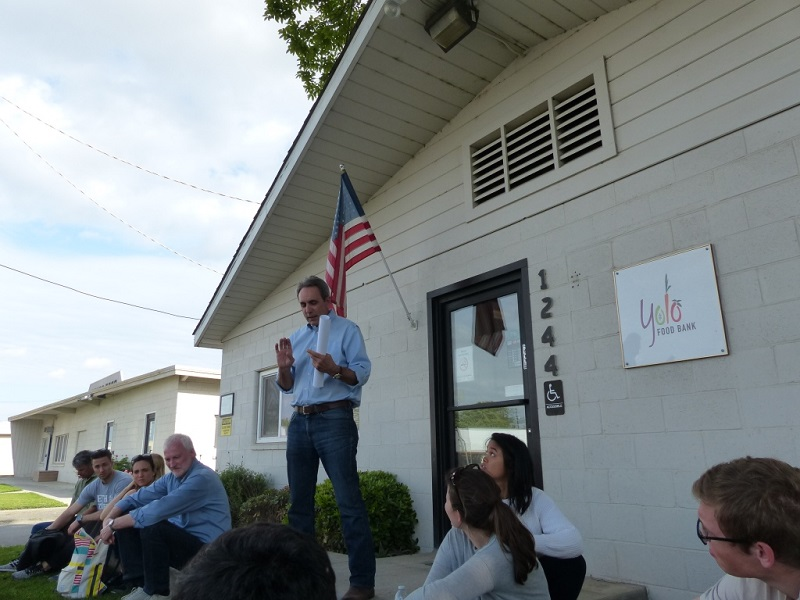 Kevin Sanchez, Executive Director of the Yolo Food Bank, introduces the food bank to the study tour