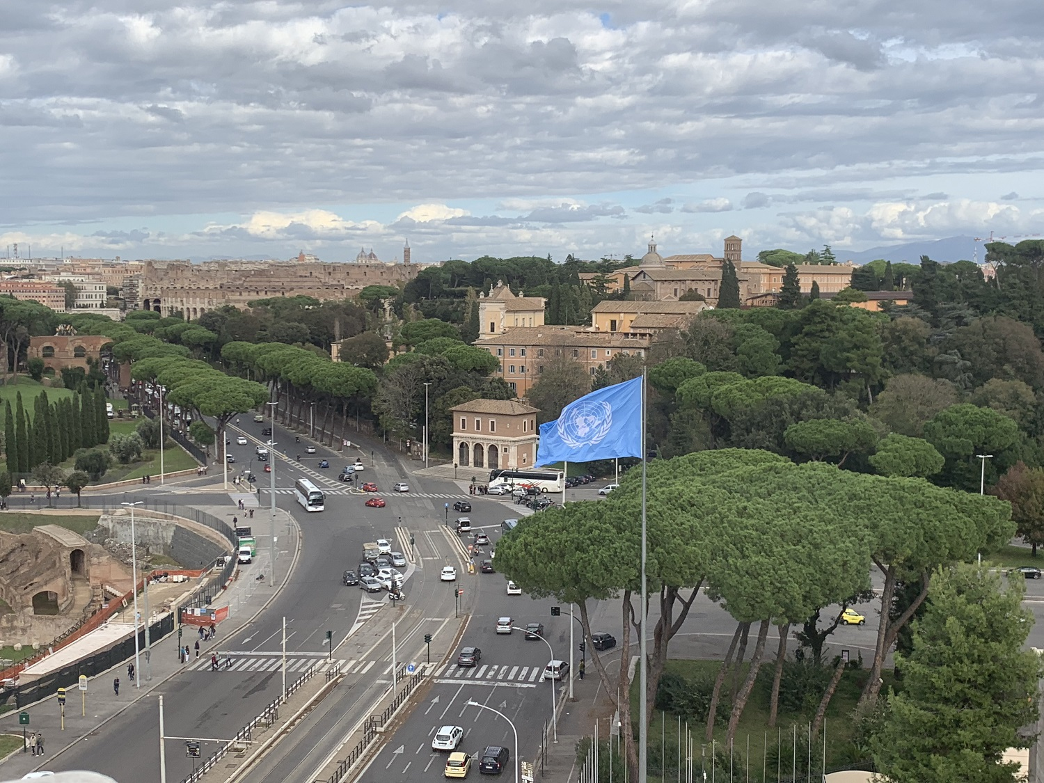 View from the FAO terrace with the UN flag waving in front of Rome's ancient city center.