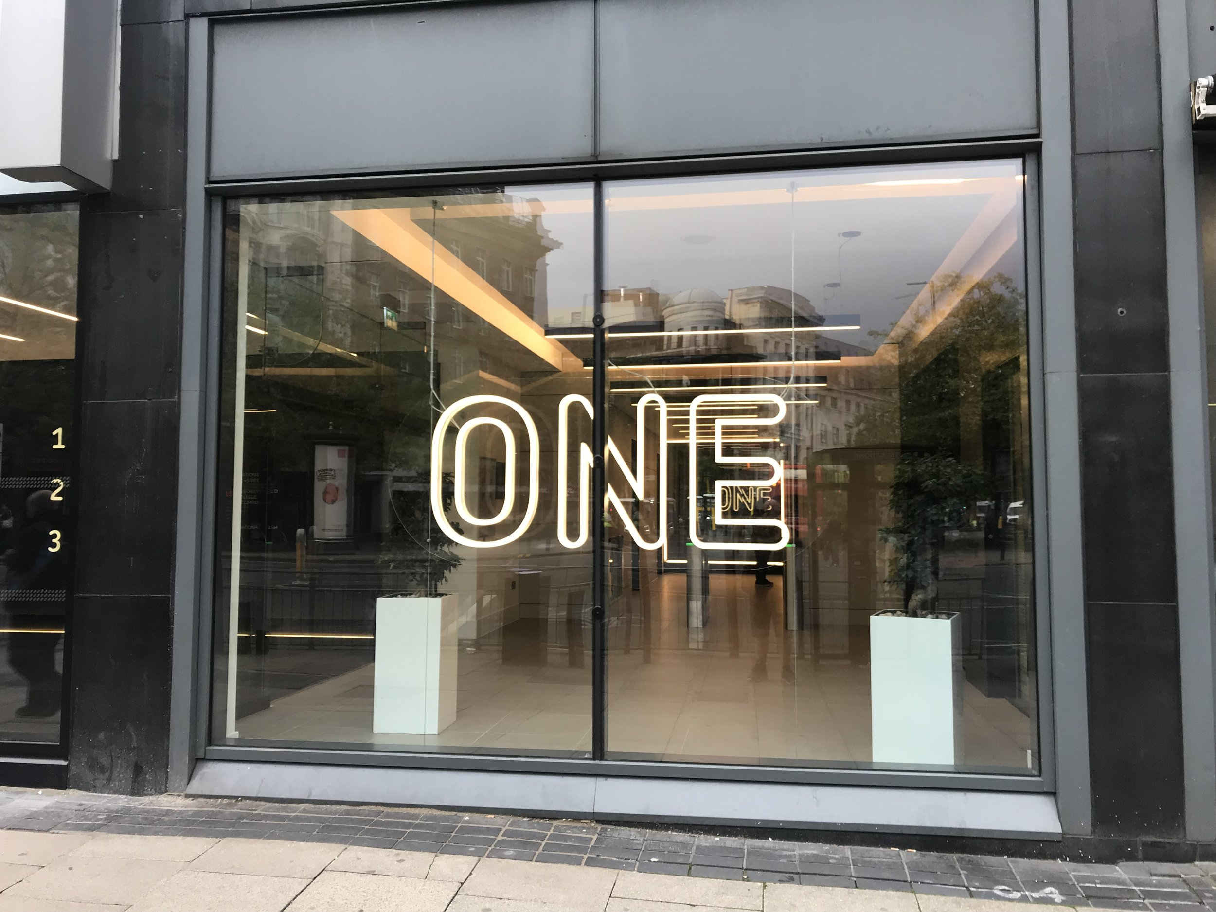 Neon Effect LED Lettering.   Neon effect LED lettering, duplicated and fixed back to back in reverse to give the same effect either way you look at it - mounted to a clear acrylic sheet to give the illusion that the sign is floating.