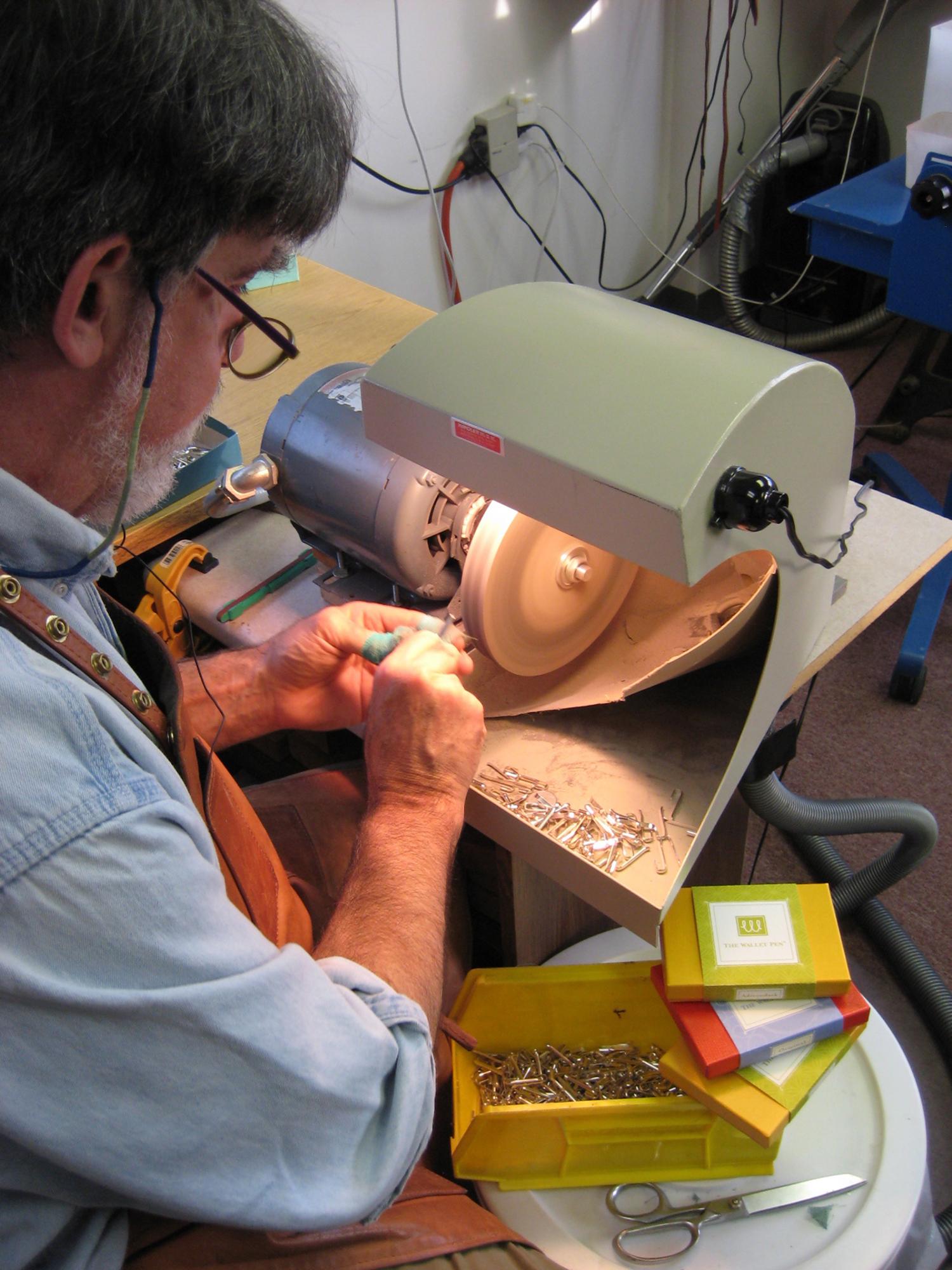 Hand crafting wallet pen in VT workshop