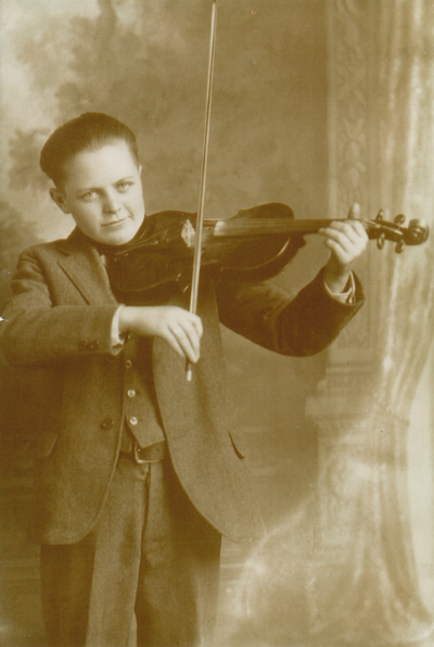 Charlie Pike, c. 1923. Why does his bow look so long?