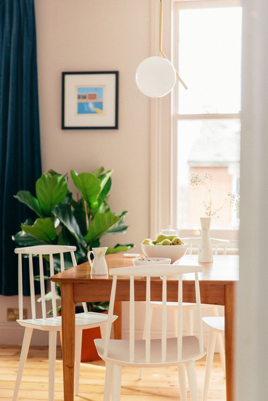 Light and bright room with table and chairs