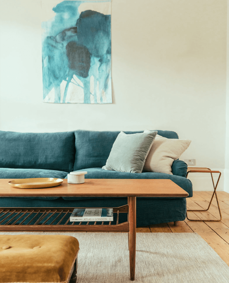 Designer living room with blue sofa and modern coffee table