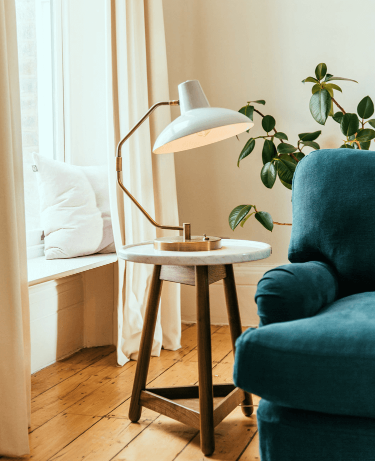 Designer lamp on side table by table