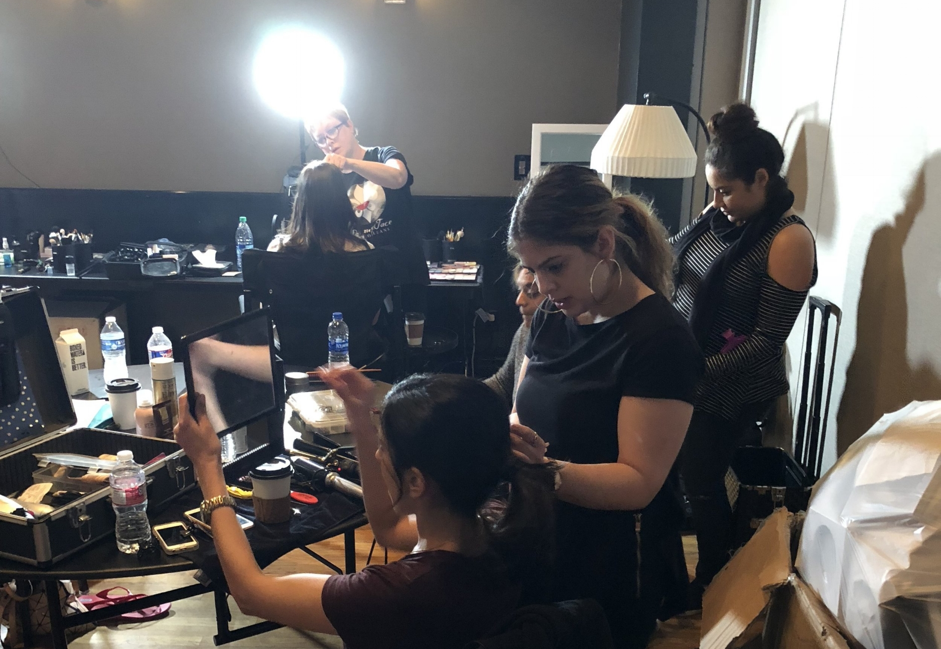 Behind the scenes of PreauxFace artists working on  Peach executives and models for the annual fashion show.