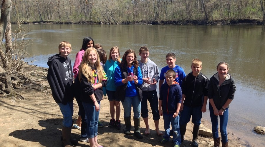 Melissa Cieniuch's 7th grade science class nurtured about three dozen Chinook salmon from eggs to 5-inches in size, and released them below Berrien Springs dam May 10, 2014.