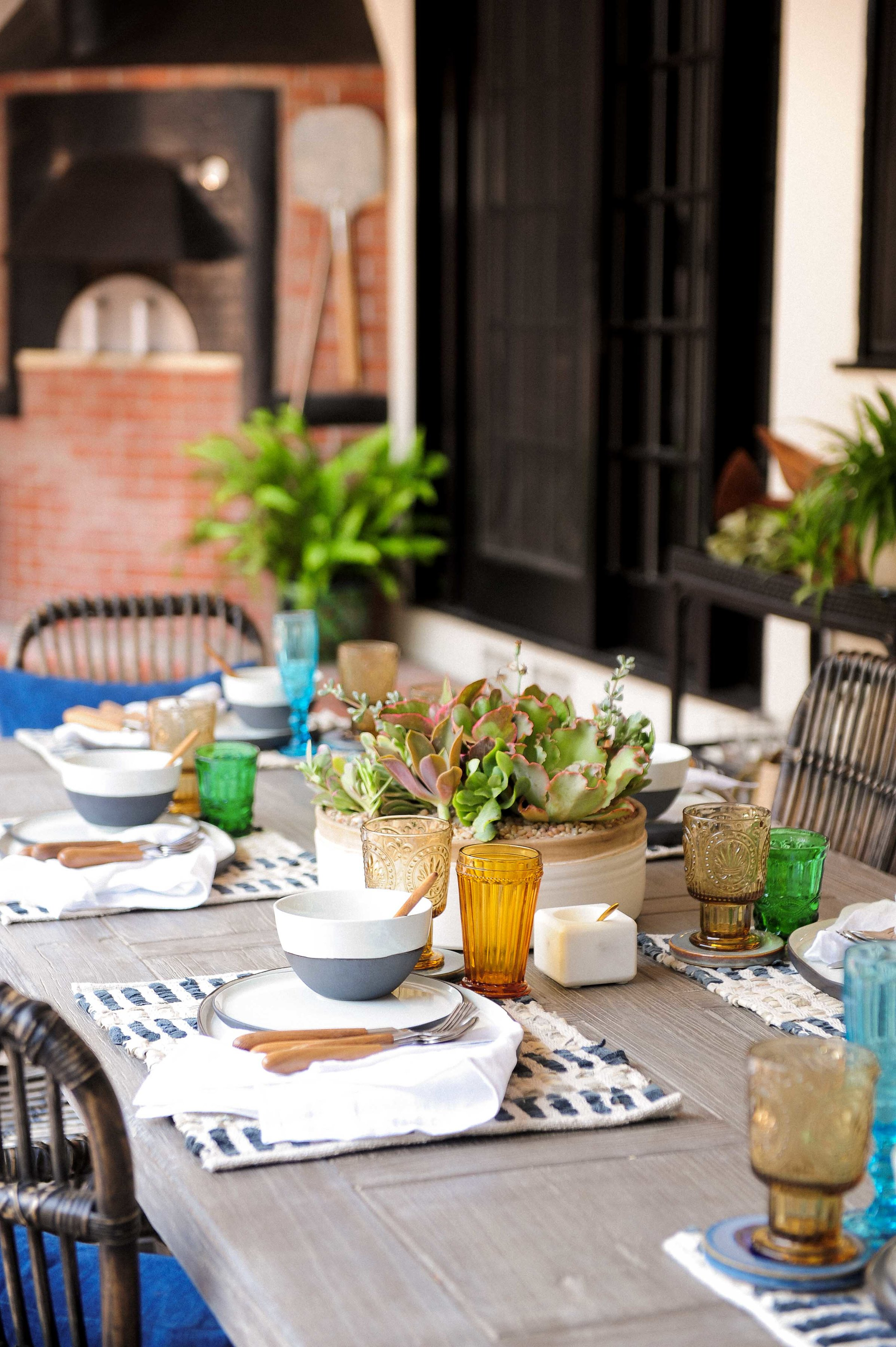 Pictured above is Punch's outdoor table styled with items from our pantry section at Rolling Greens. We love this summery eclectic al fresco vibe!!