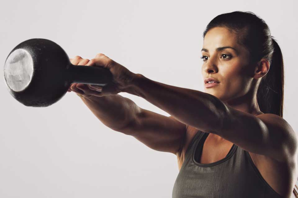 woman doing kettlebell swing