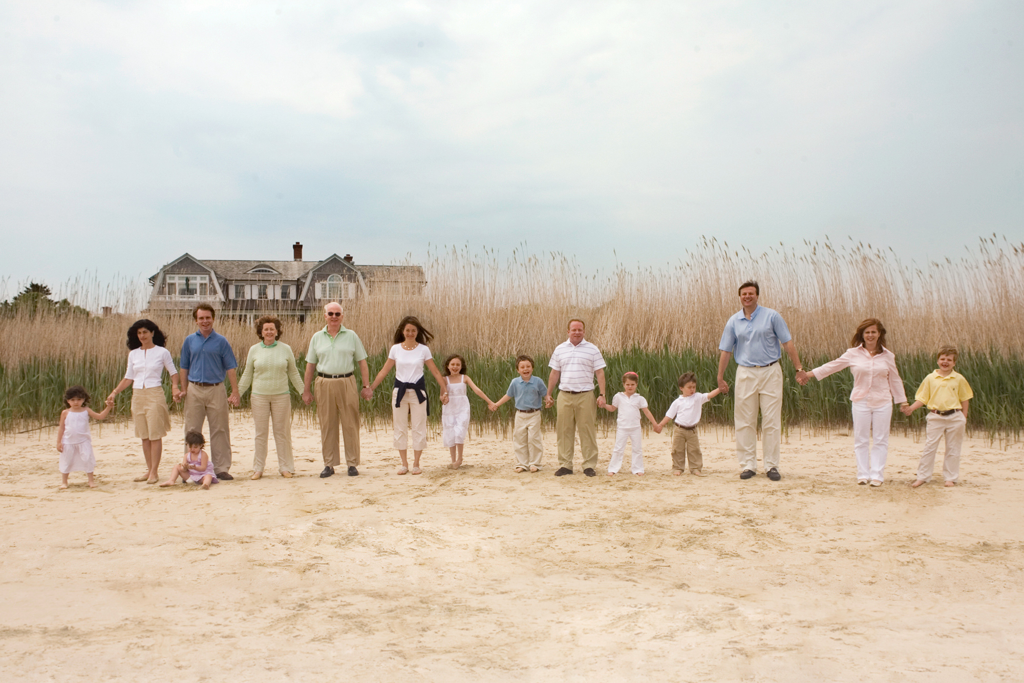 Extended Family Stands Hand in Hand on the Easthampton Beach