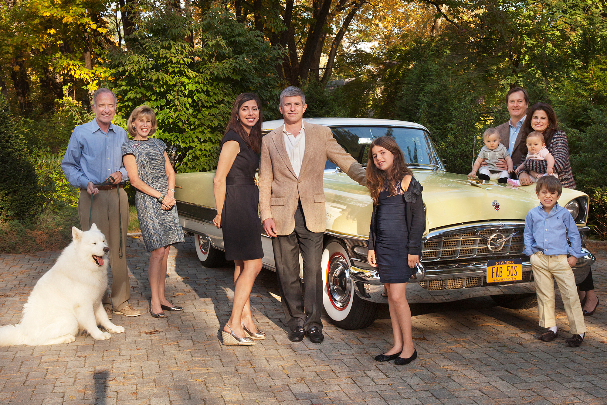 Extended Family Gathered in the Driveway of their Hamptons Summer Home