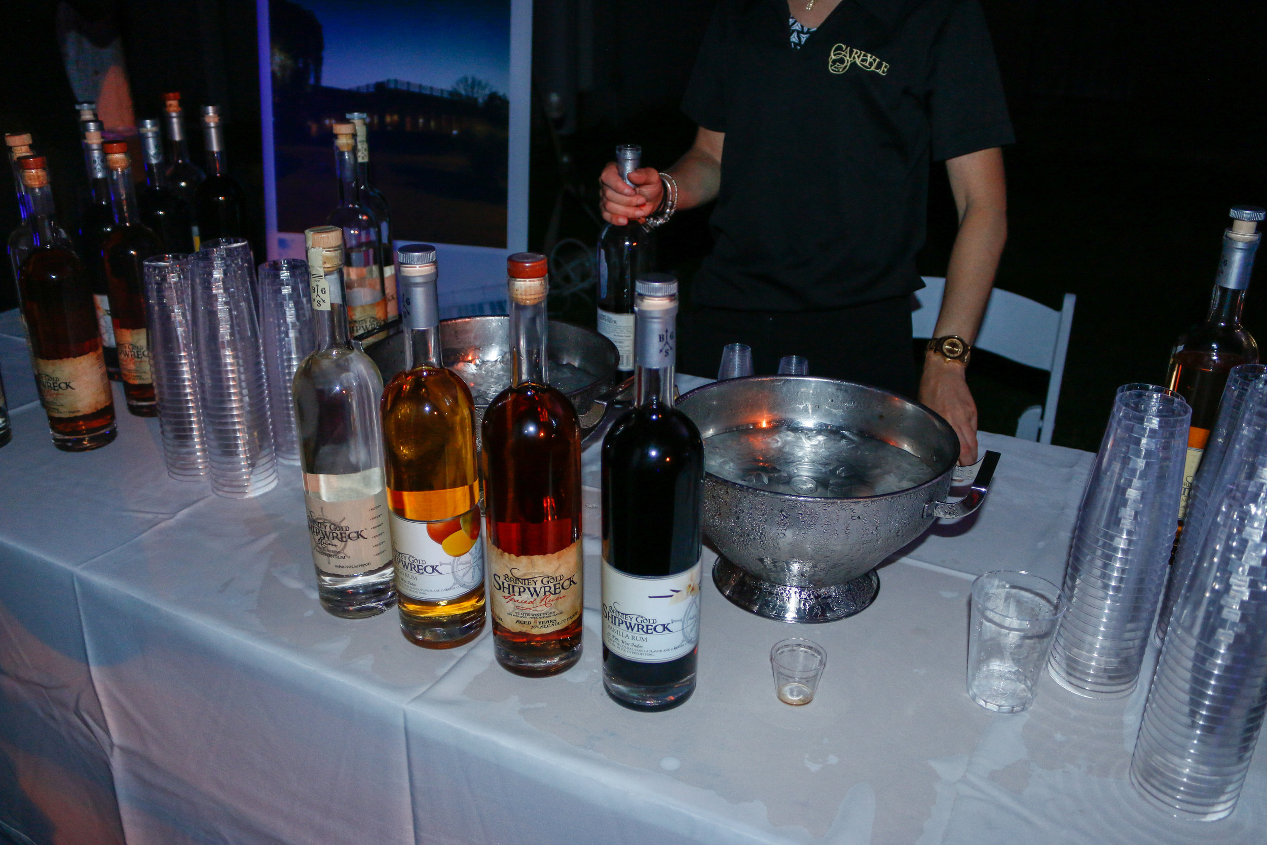 Drinks served to fuel the fun at St. Barth's most exciting night in the Hamptons!