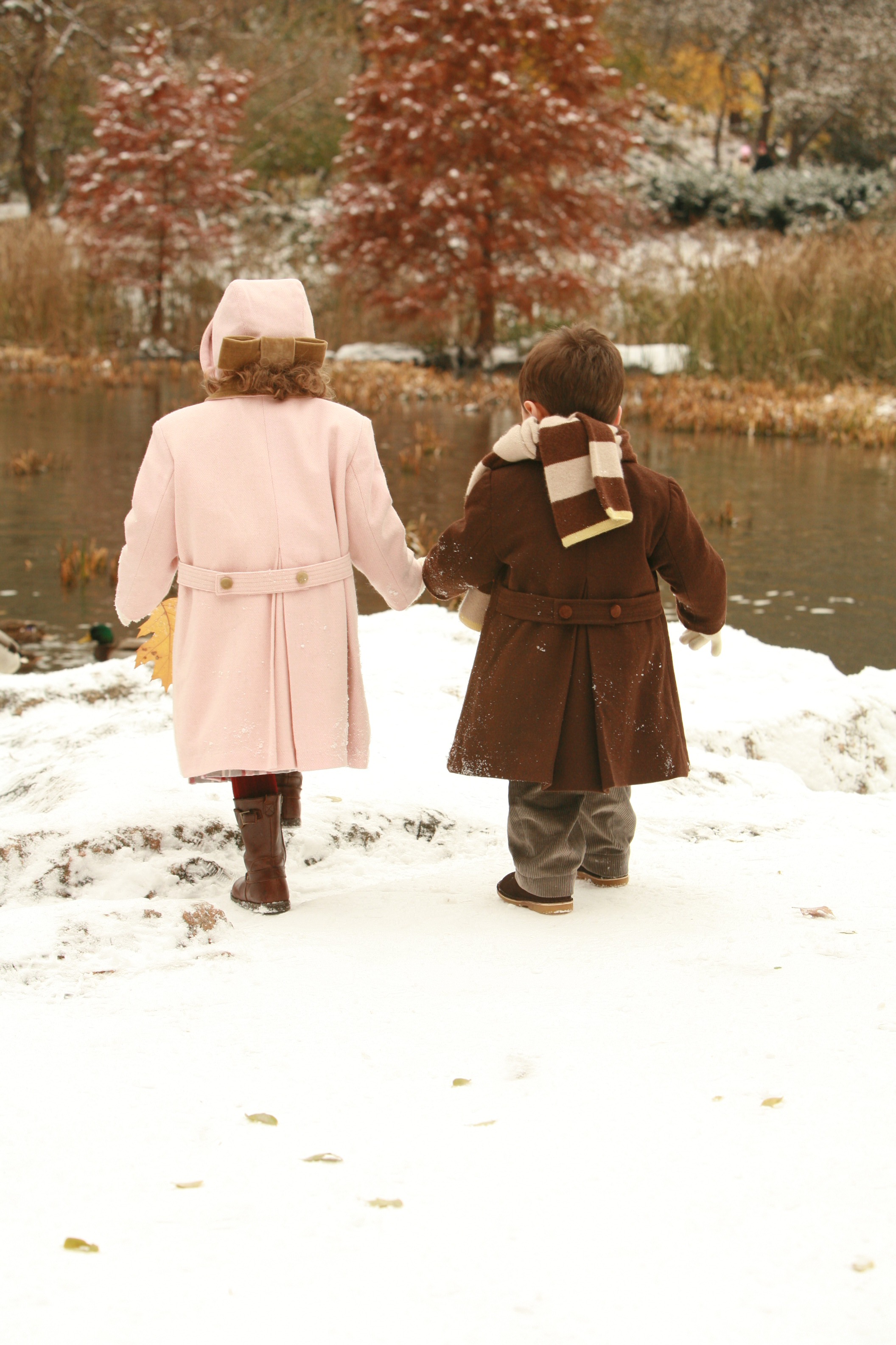 Brother and Sister Walk Through the New York Snow