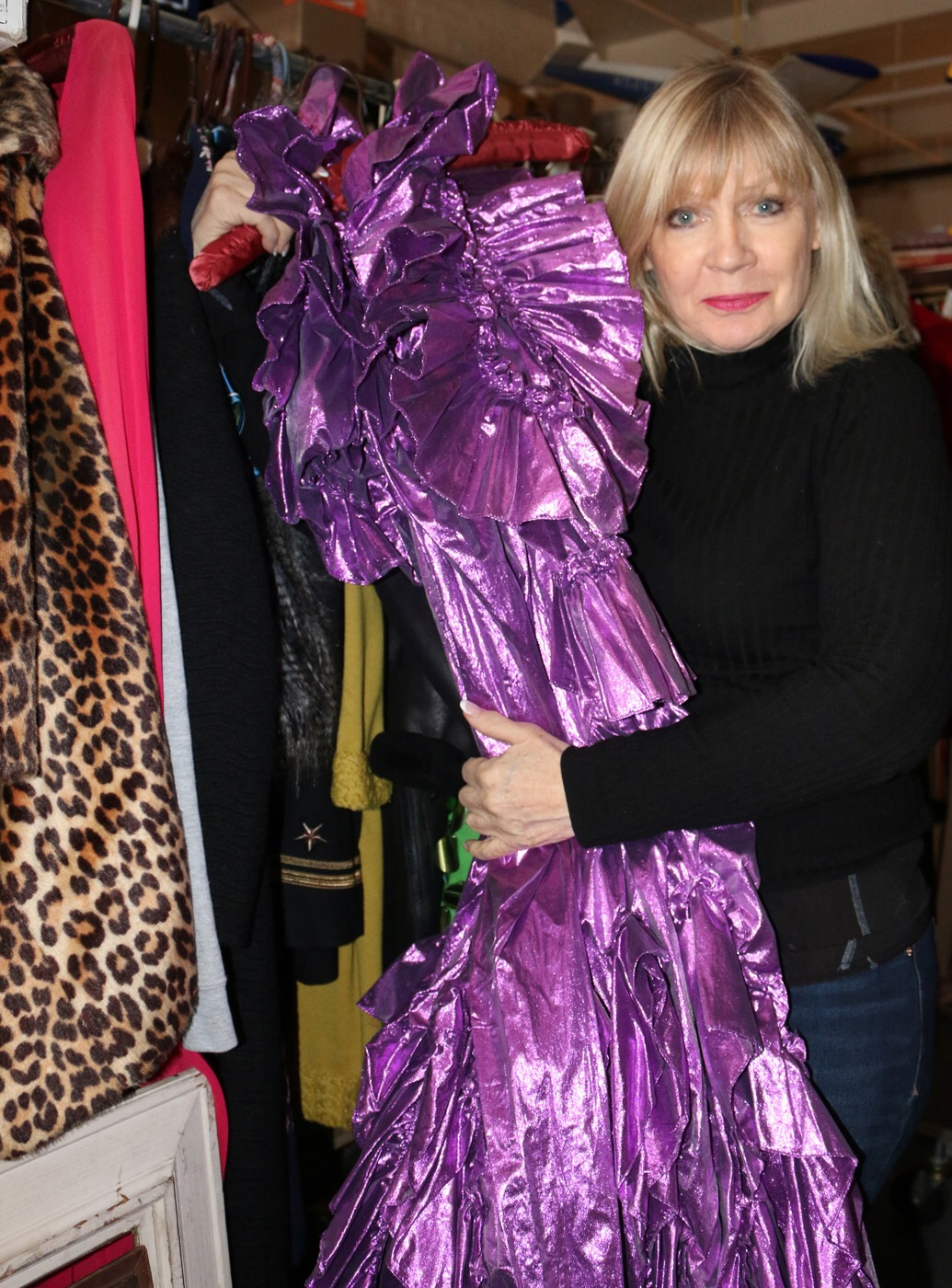 Lucille poses with a dazzling dress in her favorite color, purple.