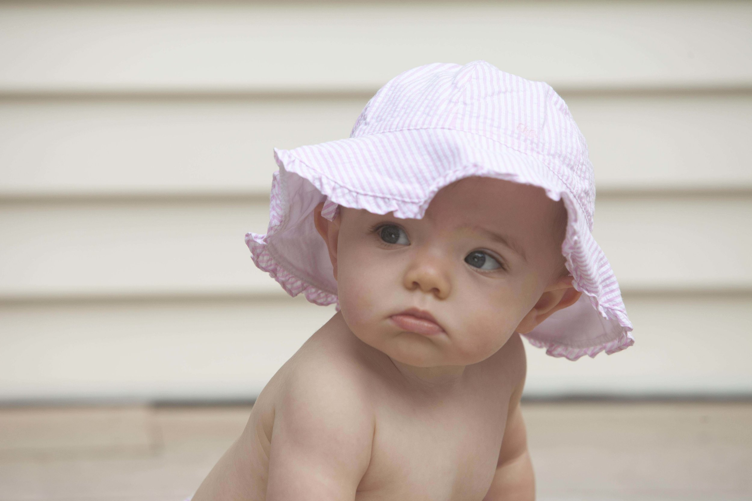 Adorable baby takes a moment to examine the world around her. Photo by Lucille Khornak.
