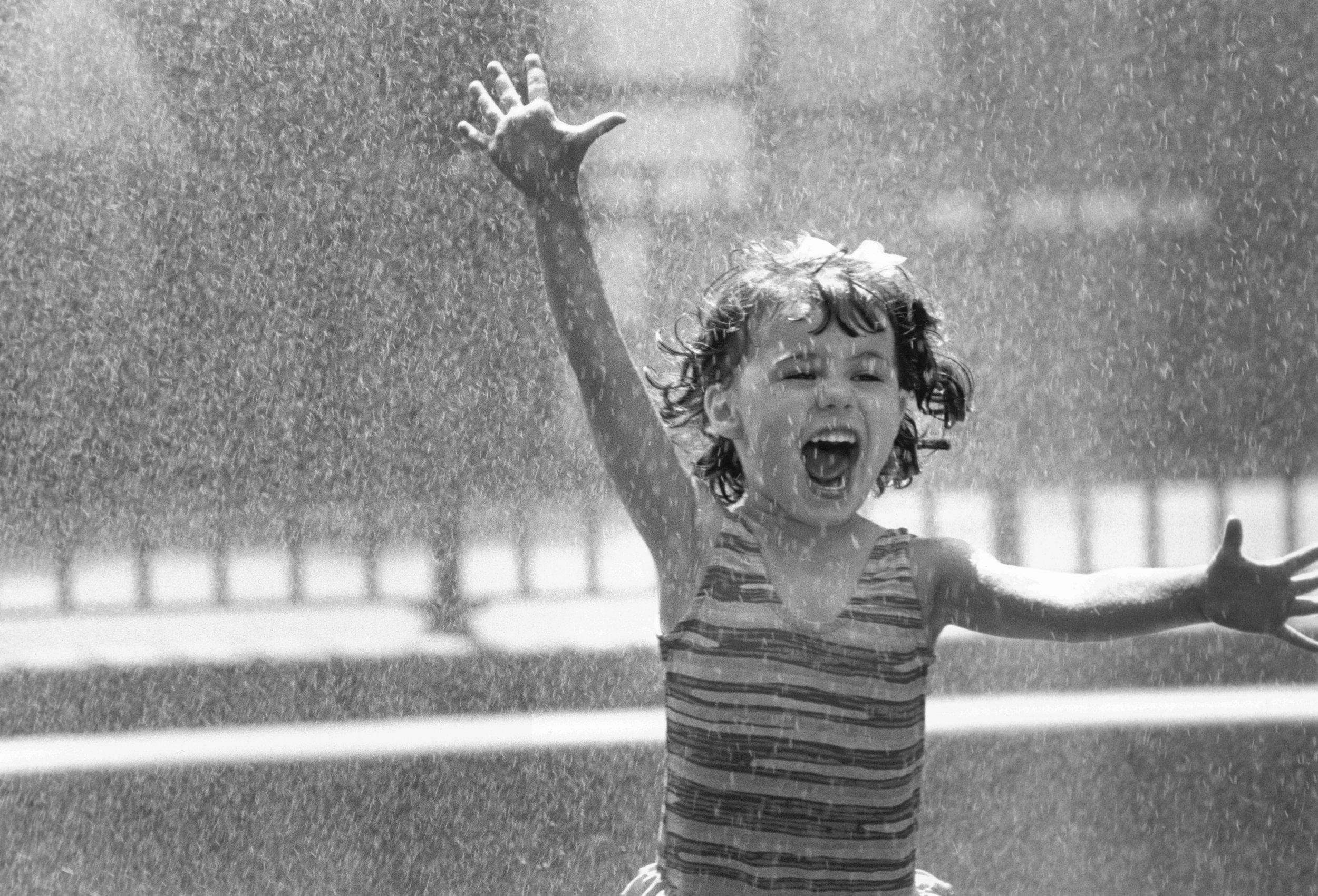 Girl going through water splash.jpg