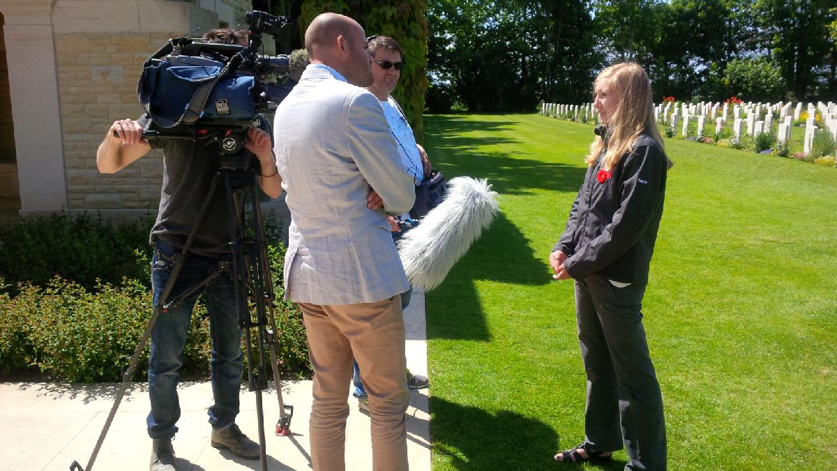 Digital Historian Taylor being interviewed for French TV following the June 6th ceremony at Beny-Sur-Mer Cemetery