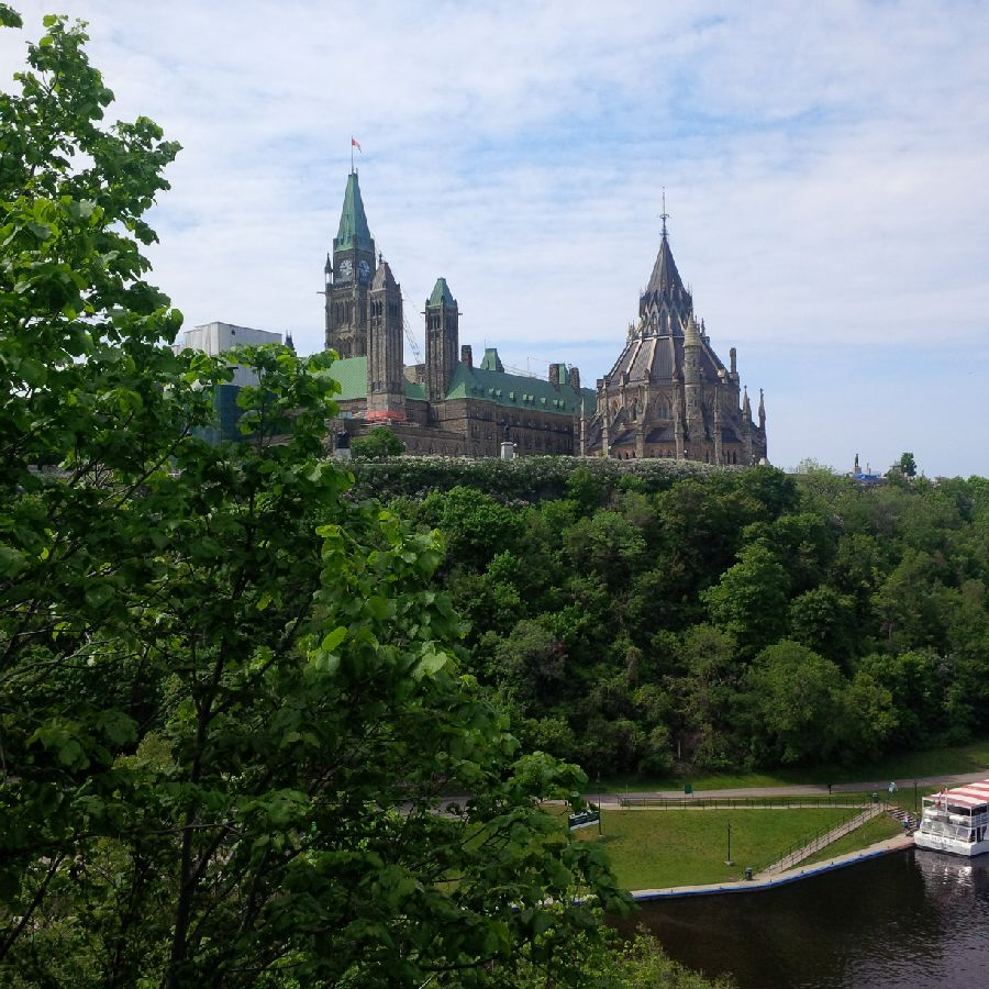 The Peace Tower and the Library of Parliament on the banks of the Ottawa River