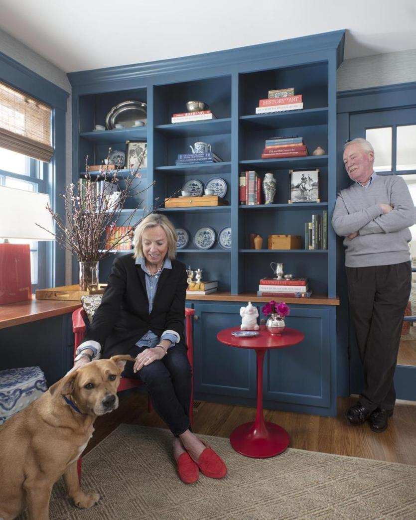 Leslie Condon plays with Patsy Cline in the study. Emily designed the built-in cabinetry, which is painted Benjamin Moore Blue Danube. A no-nonsense sisal rug adds texture.