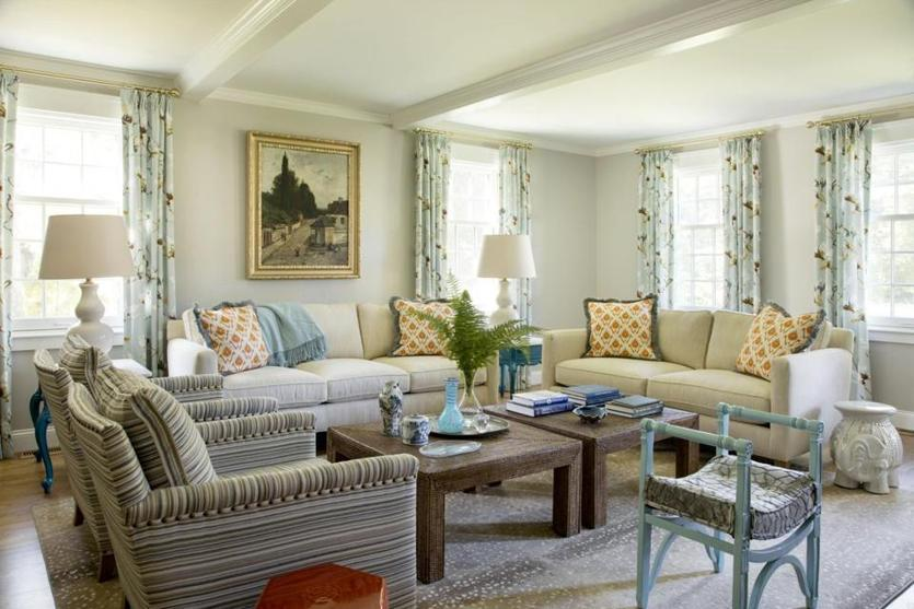 Pale-blue floral drapes add an element of the outdoors to the living room. The painting above the sofa came from homeowner Harrison Condon's parents.