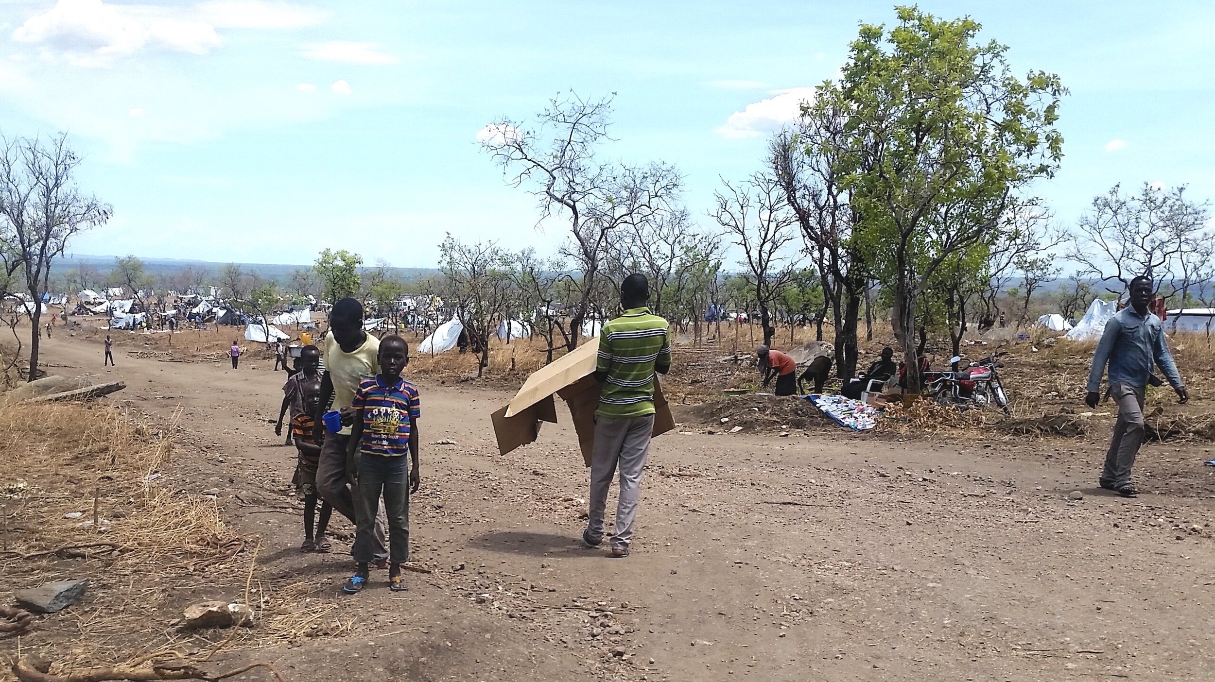 Refugees walk the dusty roads at Invepi Camp in northern Uganda.