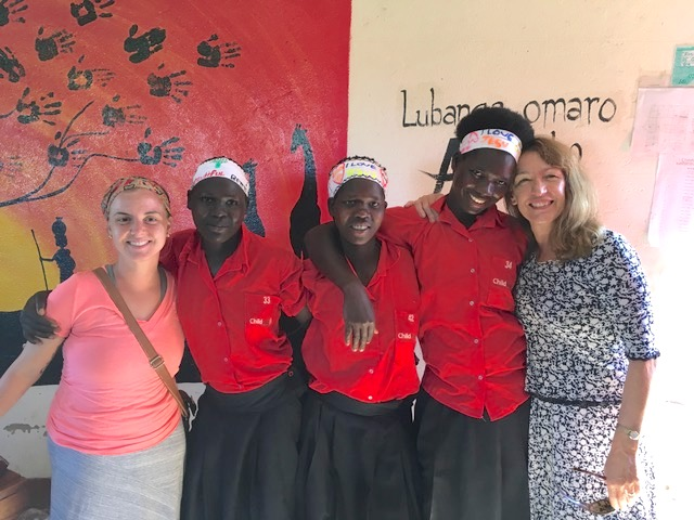 Denise (far right) with team member Cristina and several students.