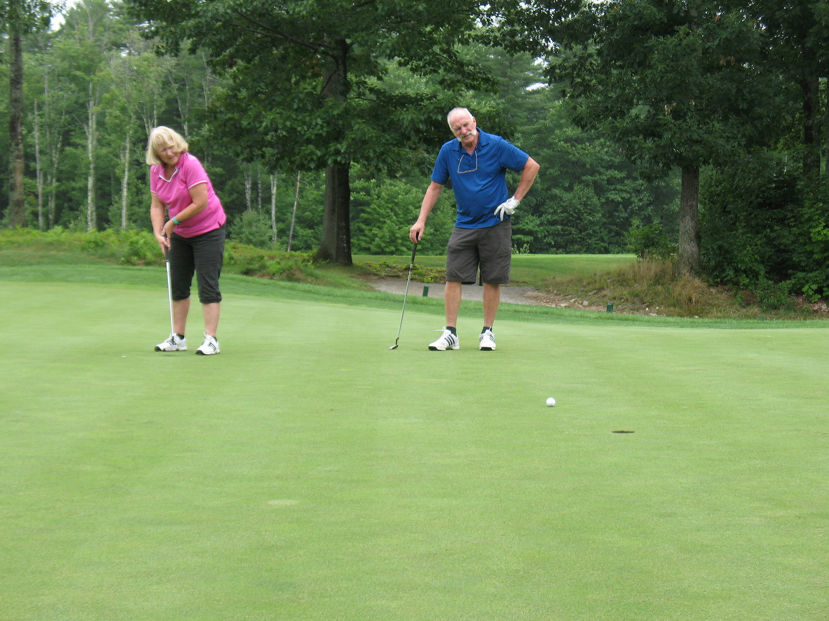 One of a handful of female golfers, Sue takes a nice putt