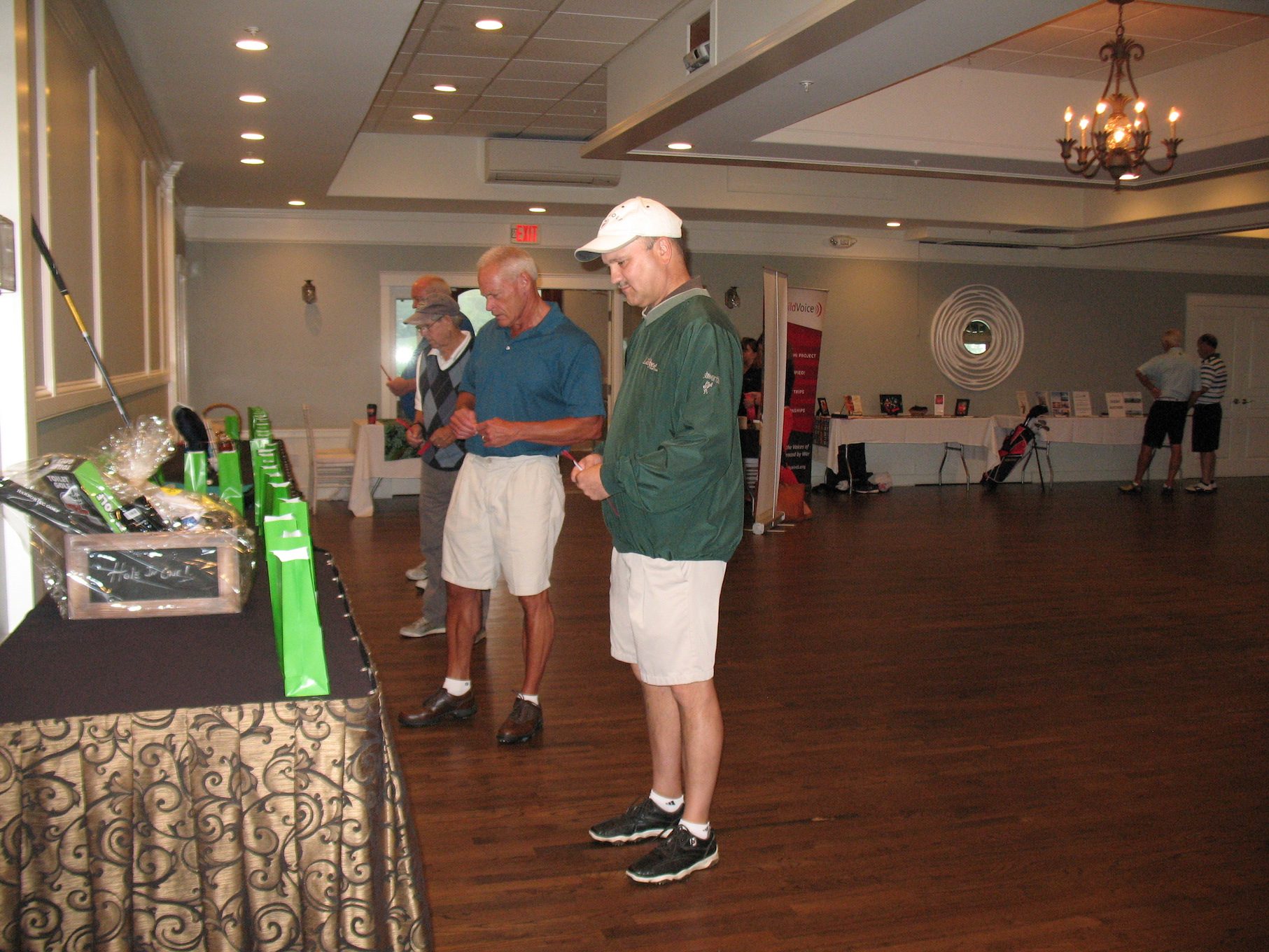 Golfers peruse all the great raffle prizes
