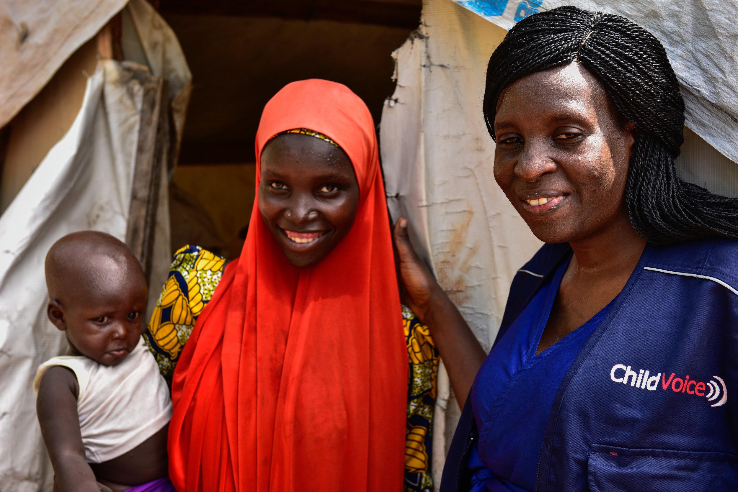 Fatima and her child with ChildVoice staff member Rebecca