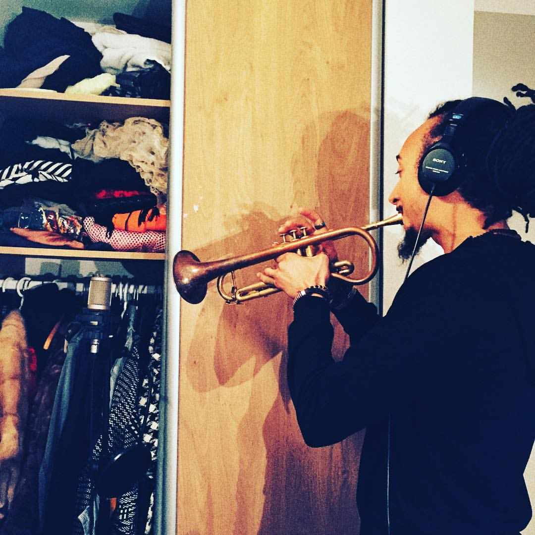 You make music where you can even in a woman's closet (even next to crinolines and fur) @theocroker #findthemic #diy #homestudio #wrongmicforahornbutwhocares #keepitinthecloset 🎺🎶😂