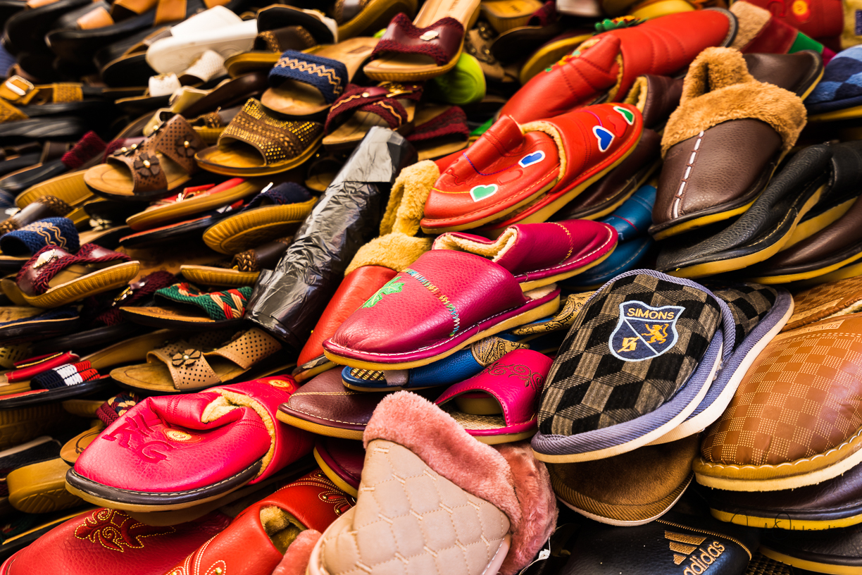 A lot of shoes on display throughout the market
