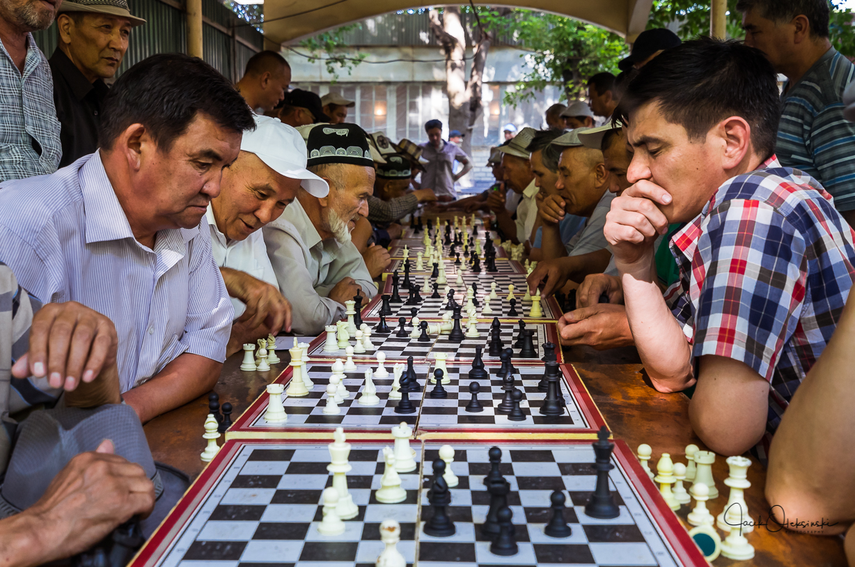 Not only consumer goods is sold at the market. People also meet to interact, here a tournament of chess