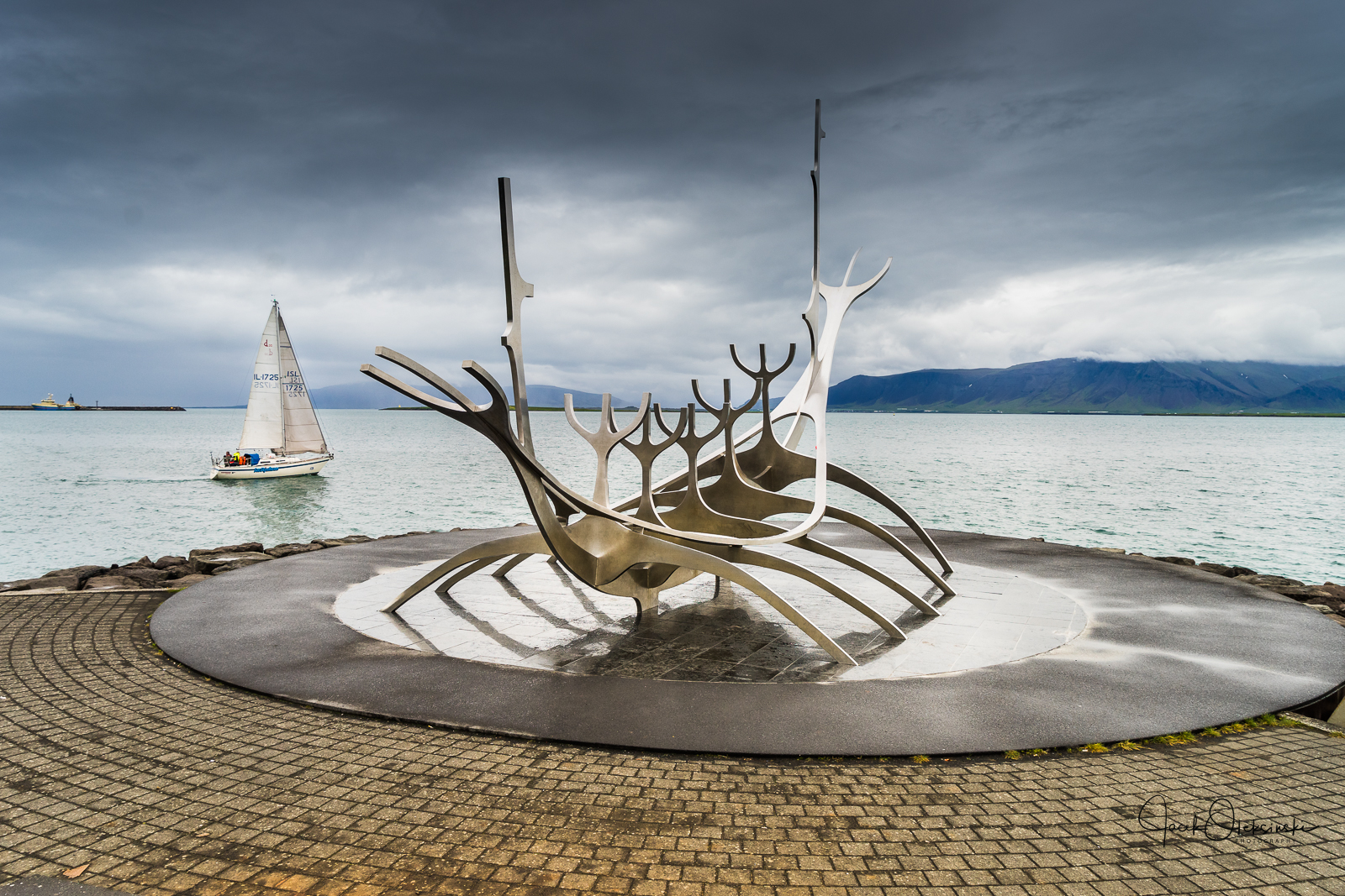 Sun Voyager (Icelandic: Sólfar) by Jón Gunnar Árnason located in the harbour