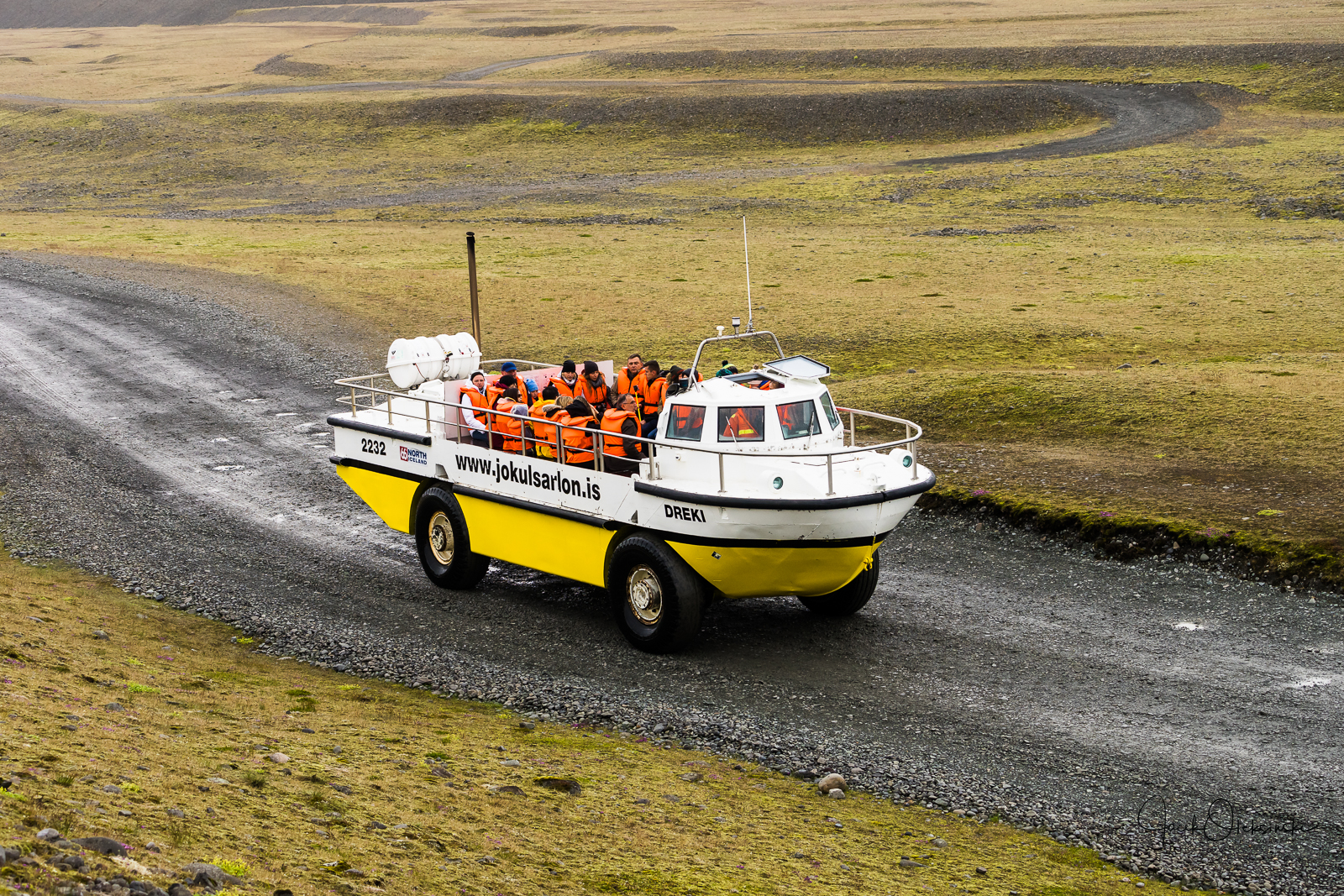 Tourists on the way with an amphibianboat