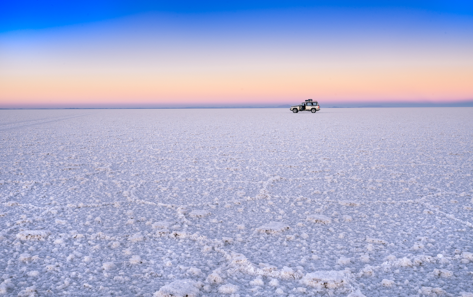 The salt flats at Salar de Uyuni during sunset.