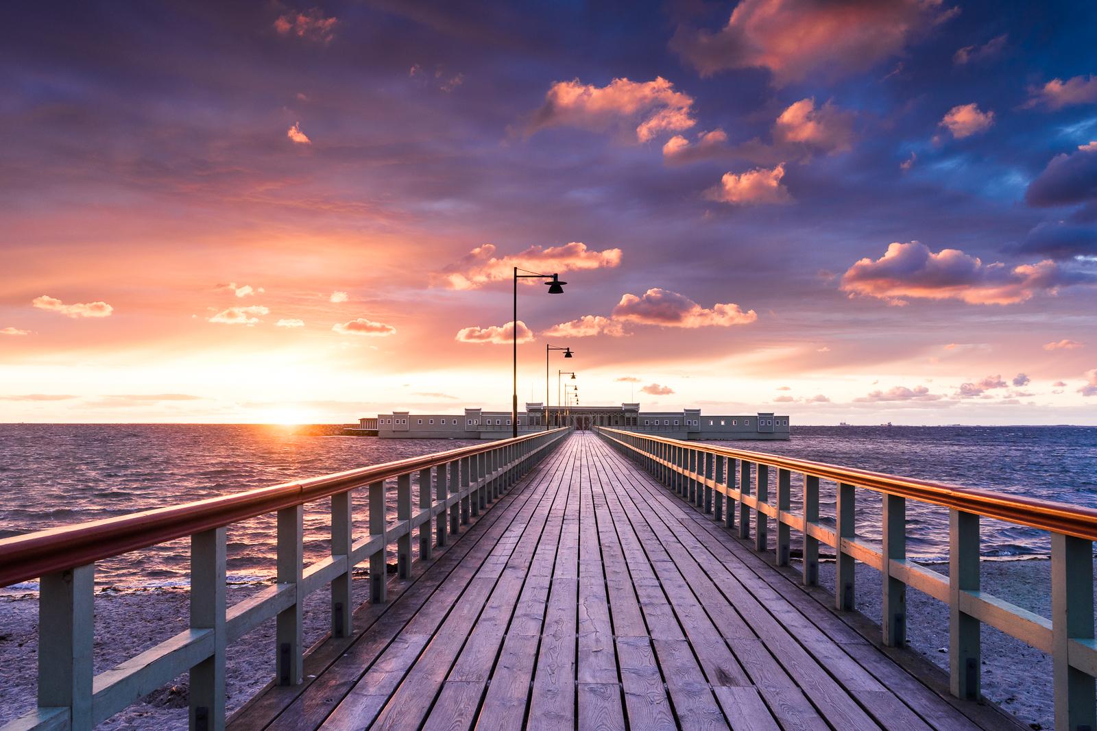 Malmö kallbadhuset during sunset.