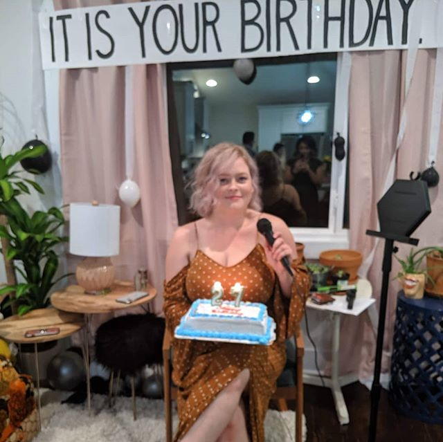 """8/19/2019 - My 27th birthday, two months into living in Nashville. • My roomies asked me what I wanted to do for my birthday. I said, """"If it involves music, the Office, plants, and food... I'll love it."""" I also insisted that by food I meant throwing a dinner party with all my new friends where I could cook a big meal from scratch. • Morning yoga. Living room decorated like a scene from the Office. THEY GOT ME A KARAOKE MACHINE. I got a plant as a gift. Went on a birthday hike (lots of plants). And then the dinner party... • It was so much of what I dreamed it to be. I made a loaf of roasted garlic and rosemary bread, two batches of pasta dough, and Alfredo sauce. I wore my apron and rolled out the pasta while some friends helped set the table I designed, some friends cooked the veggies, some friends helped hand cut the pasta, and some friends serenaded us with karaoke. We worked together to create an experience and we ate family style, passing each item around the table to fix plates. And then we karaoked until midnight. • Each item on my birthday wish list was checked off and it was amazing. I have the BEST roommates and friends, hands down. • P.S. We sat on pillows and cushions. The tables are my bedroom and closet doors on top of plastic totes. And those are curtains being used as tablecloths. 🧠"""