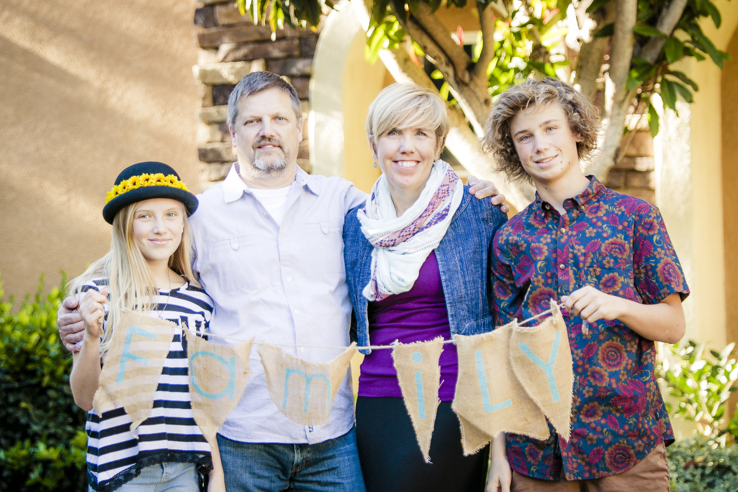 Everyone in the Cecil family coordinates with shades of purple and navy with differing patterns.