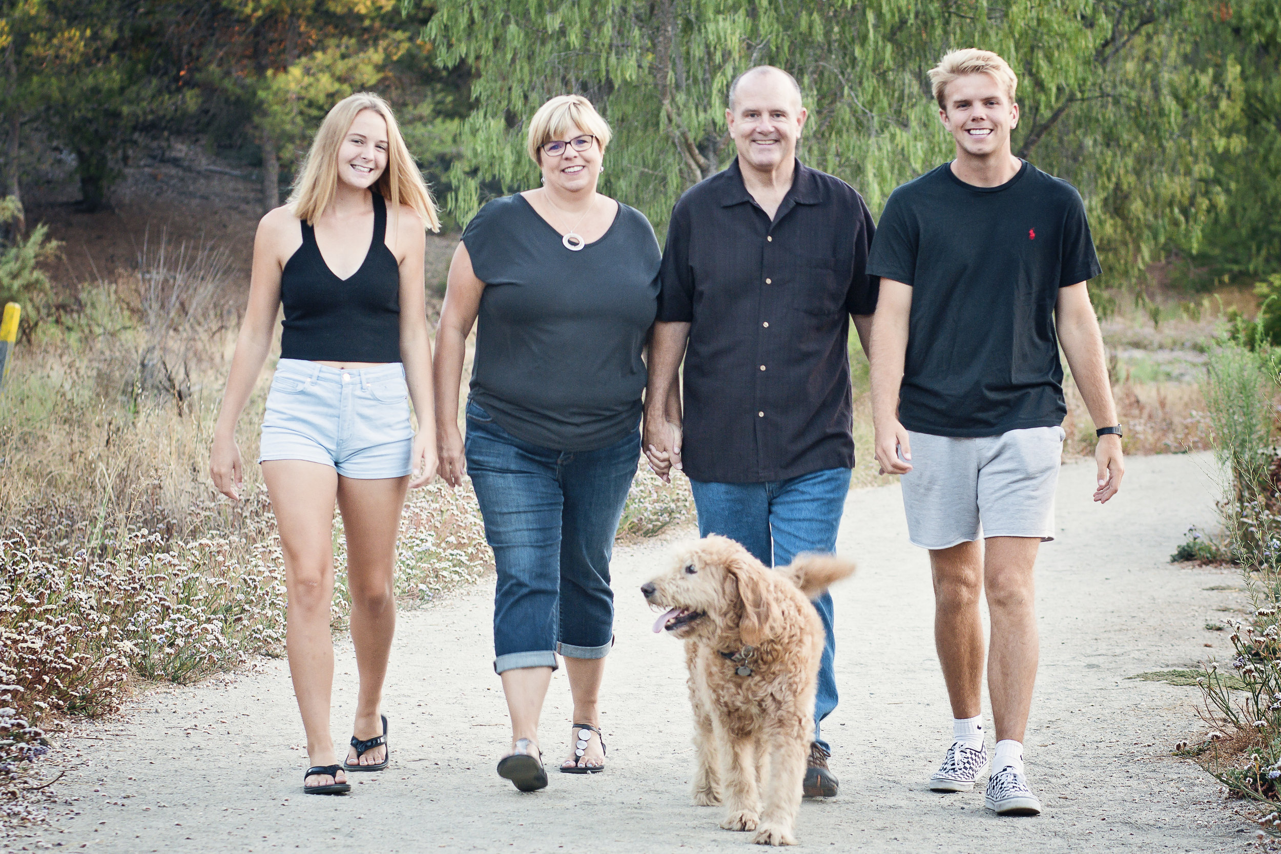 The Swanson family is matchy. They are all wearing black shirts and denim.