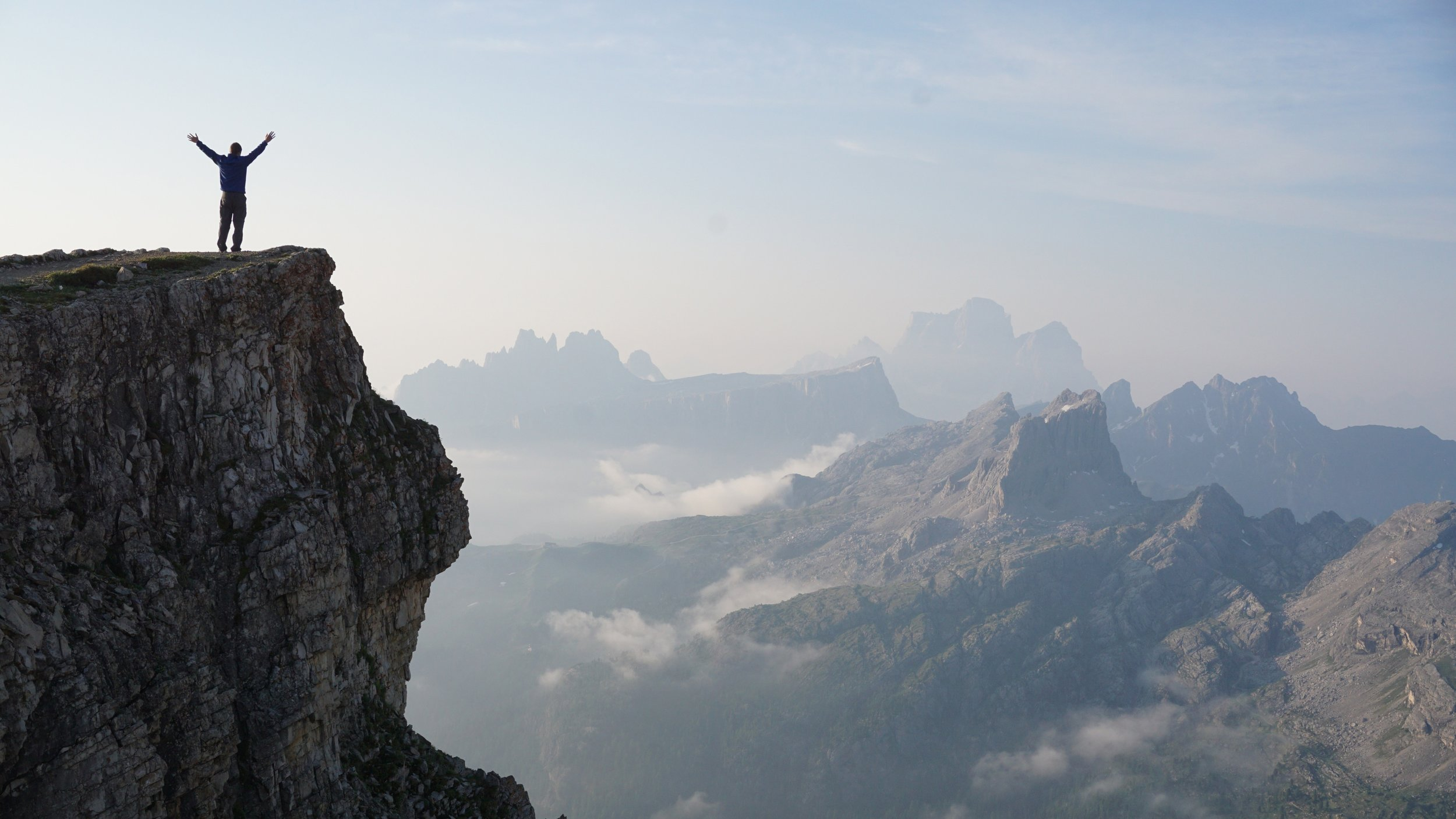 Man Worshiping From a Mountain Top Christian Stock Photo.jpg